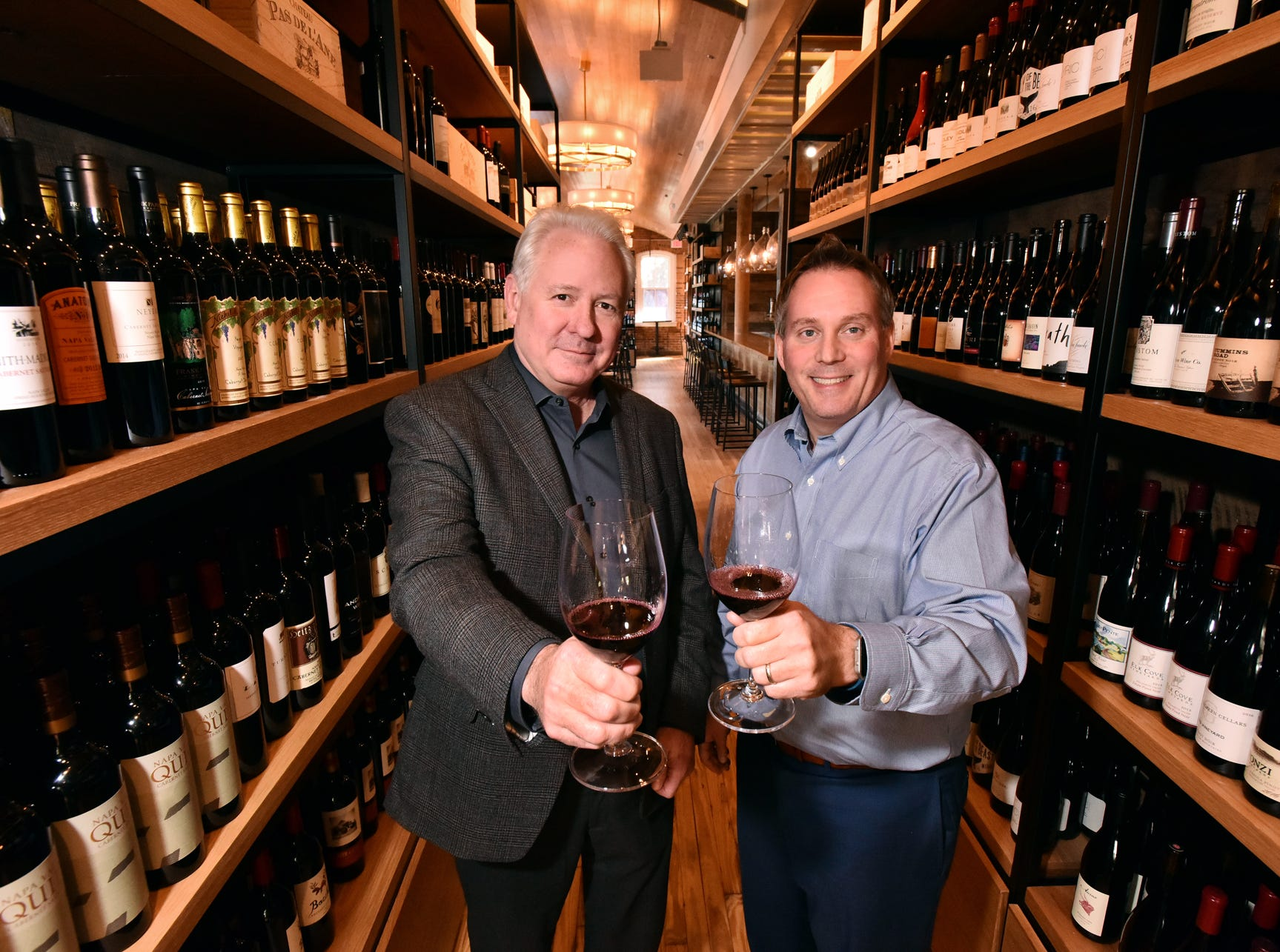 Foxcroft Wine Co. owner Conrad Hunter and manager Eric Heidal have opened a location on S. Main Street in Greenville.