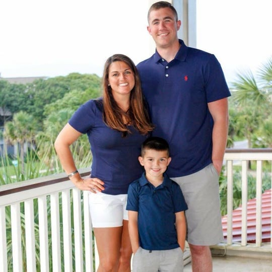 Greenville police officer Nikki Morton with her boyfriend, Kyle Bowdoin, and her son, Kade Hyatt