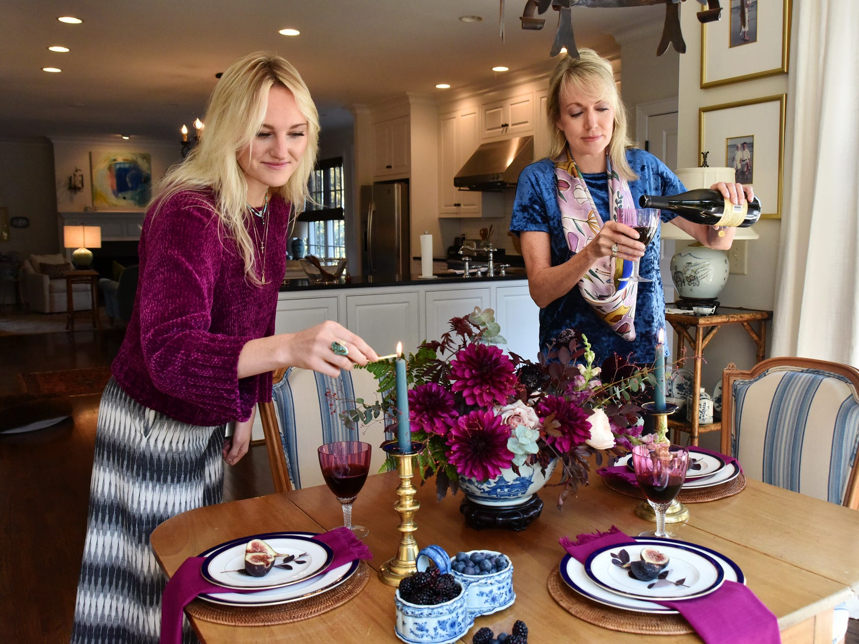 Kelsey Olsen, left, and her Jeanne, set up a tablescape.