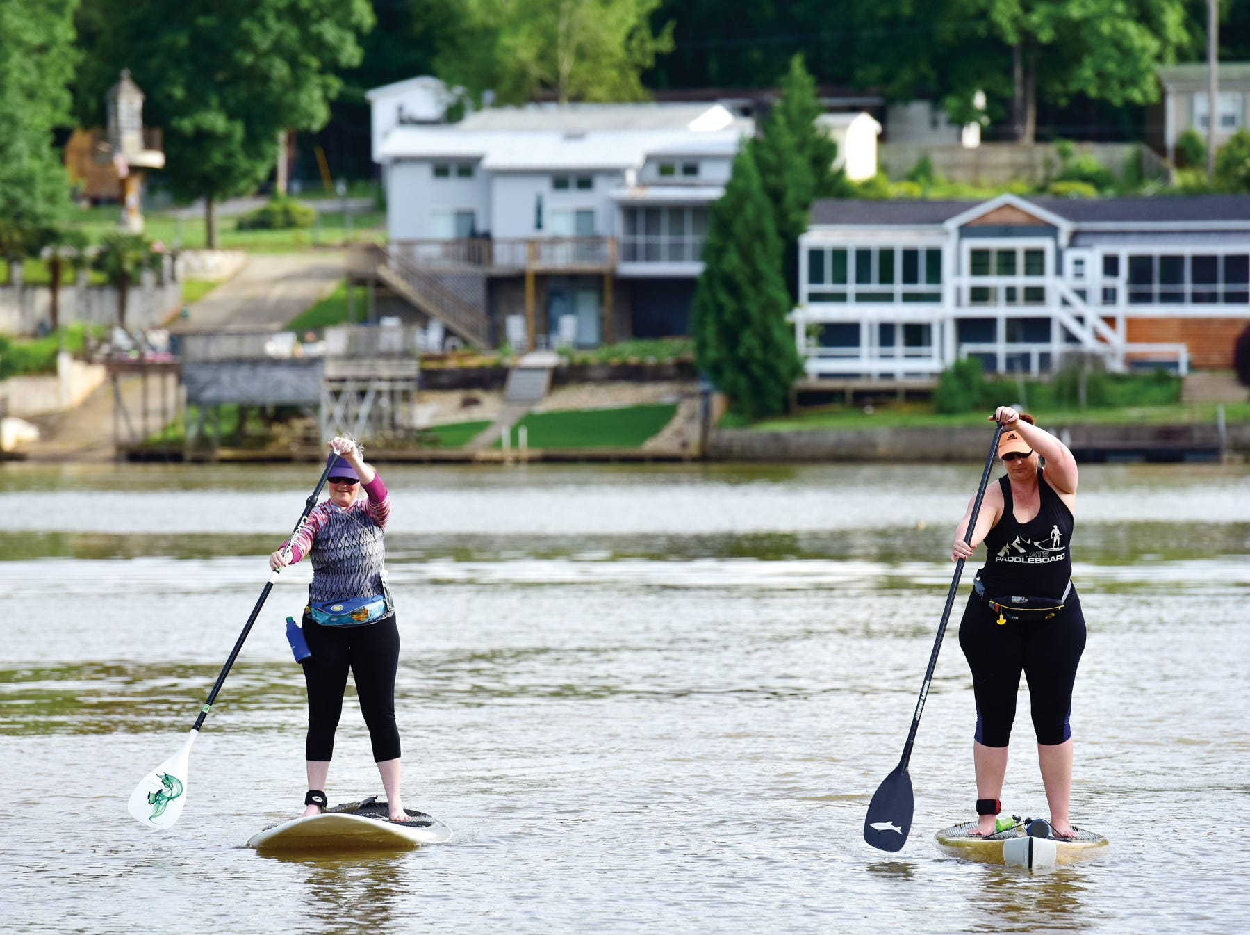 Cristy Carter, right, and Margaret Graham paddle on Saluda Lake in Greenville.