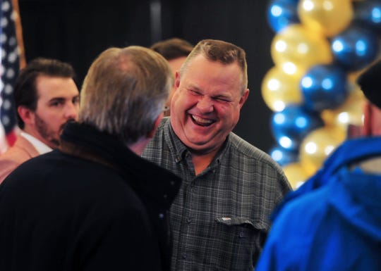 Sen. Jon Tester mingles with supporters early in the evening, during his November election night party at the Holiday Inn in Great Falls.