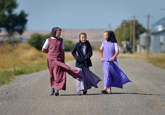 Students return from lunch in 2018 at the Deerfield Hutterite Colony in Fergus County.