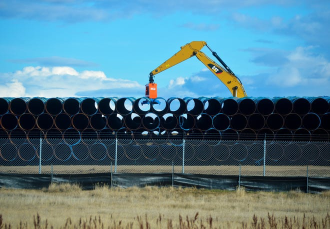 Pipe for the proposed Keystone XL Pipeline was being loaded at a pipe yard in northern Phillips County in the fall. WildEarth Guardians is suing the U.S. Department of Transportation arguing that smaller pipelines crossing federal lands have insufficient inspection.