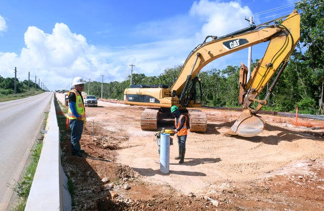 Employees of Black Construction Company continue work at the ongoing project of widening the road, along the southbound lane of Route 3 in Dededo, on Friday, Dec 28, 2018.