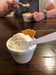 Rich, creamy ice cream often accompanies meals at Bliss Artisan on Main Street. The ice cream and pizza parlor features many specialty frozen treats, including the fried corn ice cream at foreground.