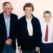 Matt Nelson is shown as a child, right, with late grandfather Lowell Palmer, left, and grandmother Mary.