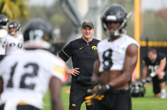 Iowa Hawkeyes defensive coordinator Phil Parker watches his players prepare Friday for the Outback Bowl matchup with Mississippi State.
