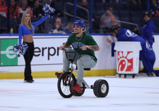 Iowa Hawkeyes defensive back Amani Hooker (27) rides a tricycle during a contest against Mississippi State in the first intermission of the Tampa Bay Lightning game Thursday, December 27, 2018 at Amalie Arena.