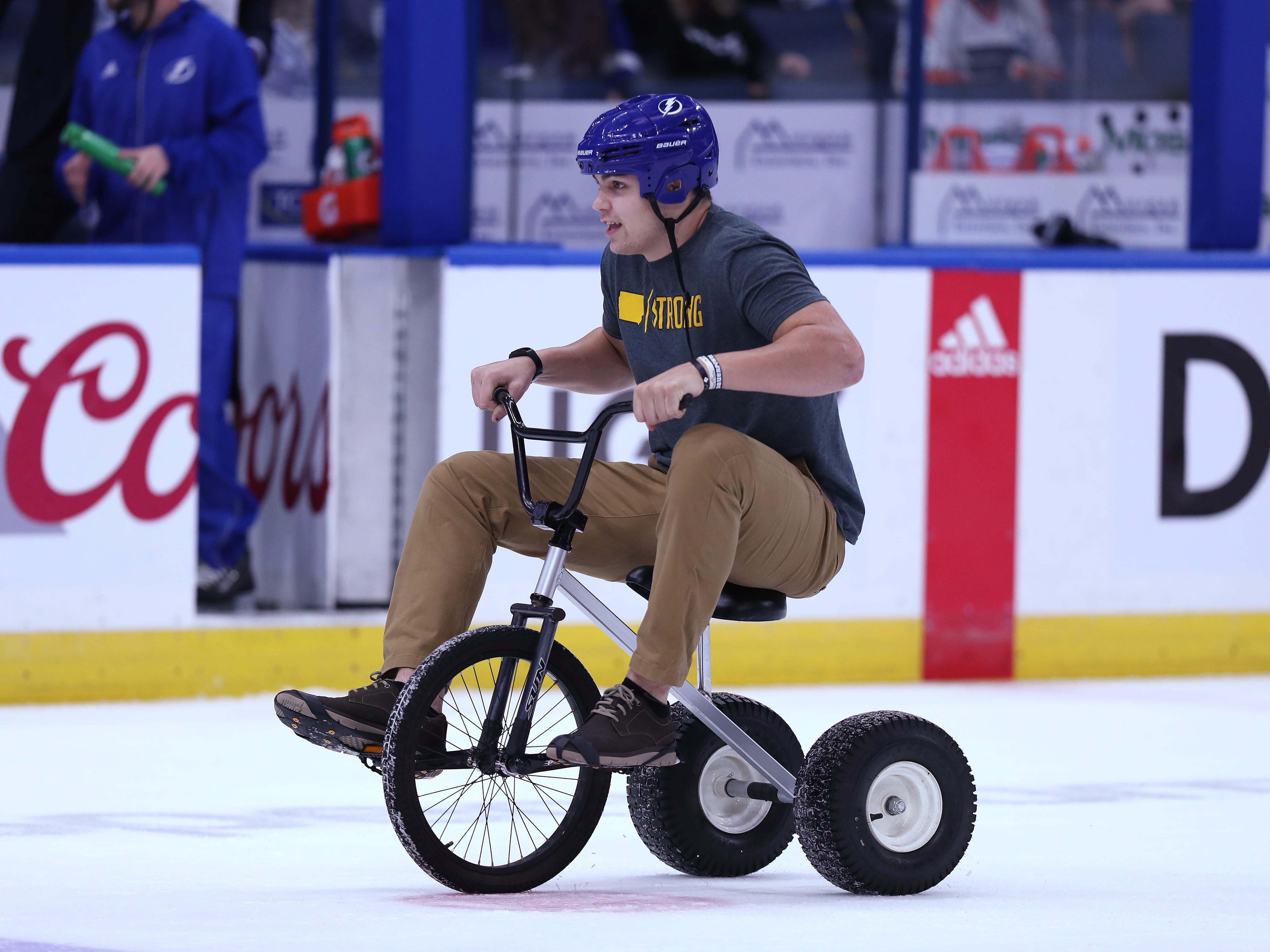 Iowa Hawkeyes quarterback Nate Stanley (4) rides a tricycle on the ice during a contest against Mississippi State in the first intermission of the Tampa Bay Lightning game Thursday, December 27, 2018 at Amalie Arena.
