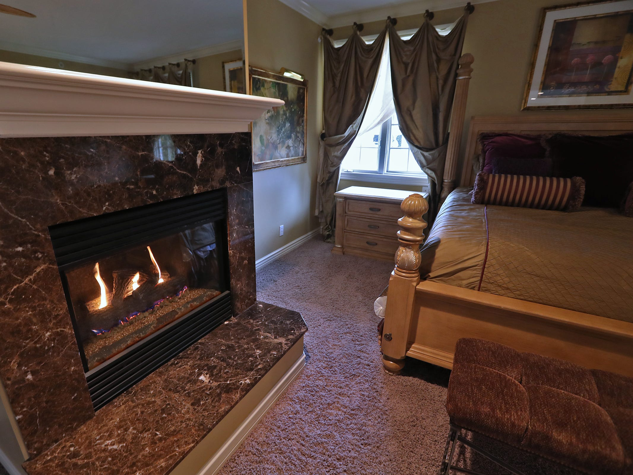 This is the master bedroom in the home at 1270 Laurelwood Ct. in Carmel, Friday, Dec. 28, 2018.  It includes a two-sided fireplace.