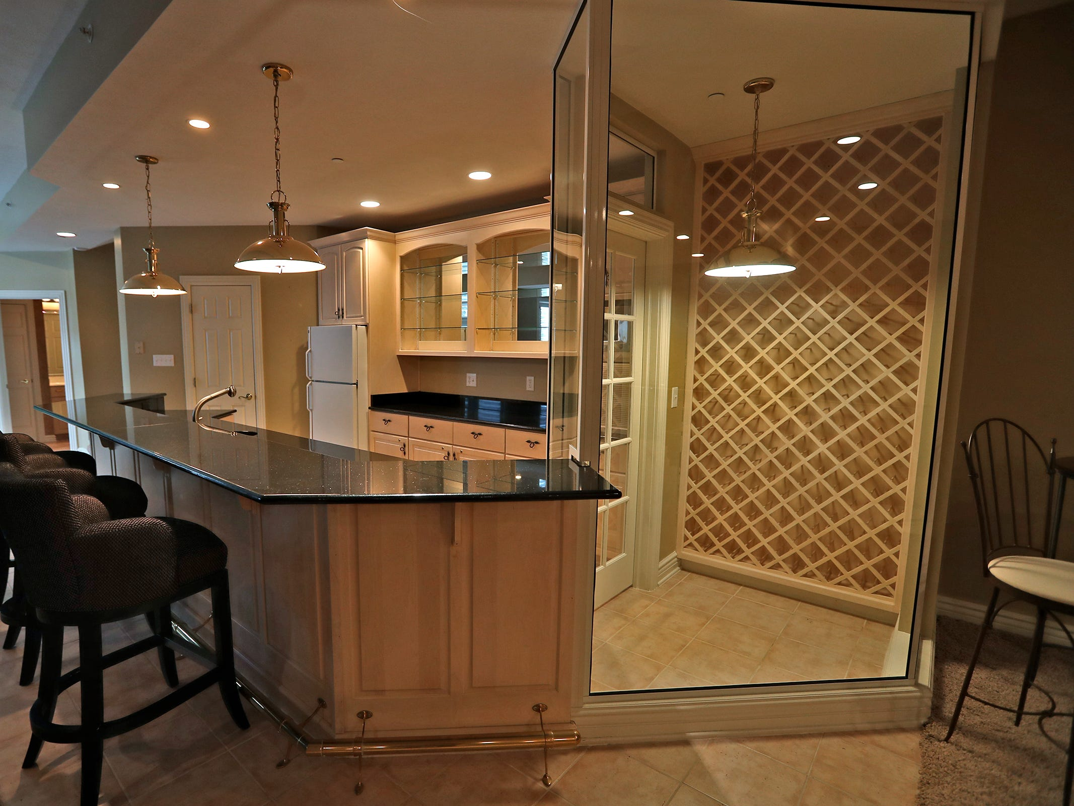 This is a kitchen and bar with a wine cabinet in the basement of the home at 1270 Laurelwood Ct. in Carmel, Friday, Dec. 28, 2018.