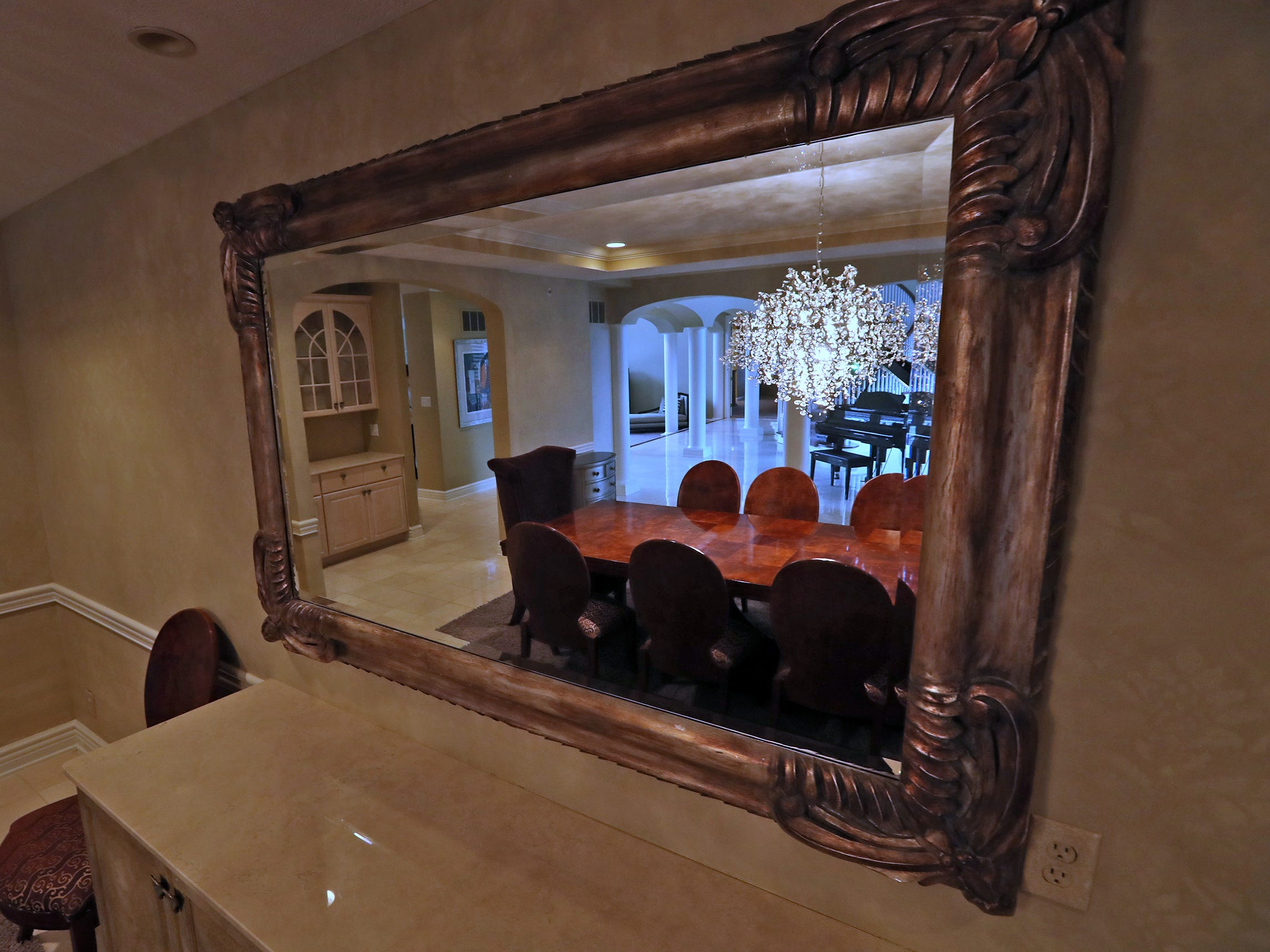 Reflected in a mirror is the dining room in the home at 1270 Laurelwood Ct. in Carmel, Friday, Dec. 28, 2018.