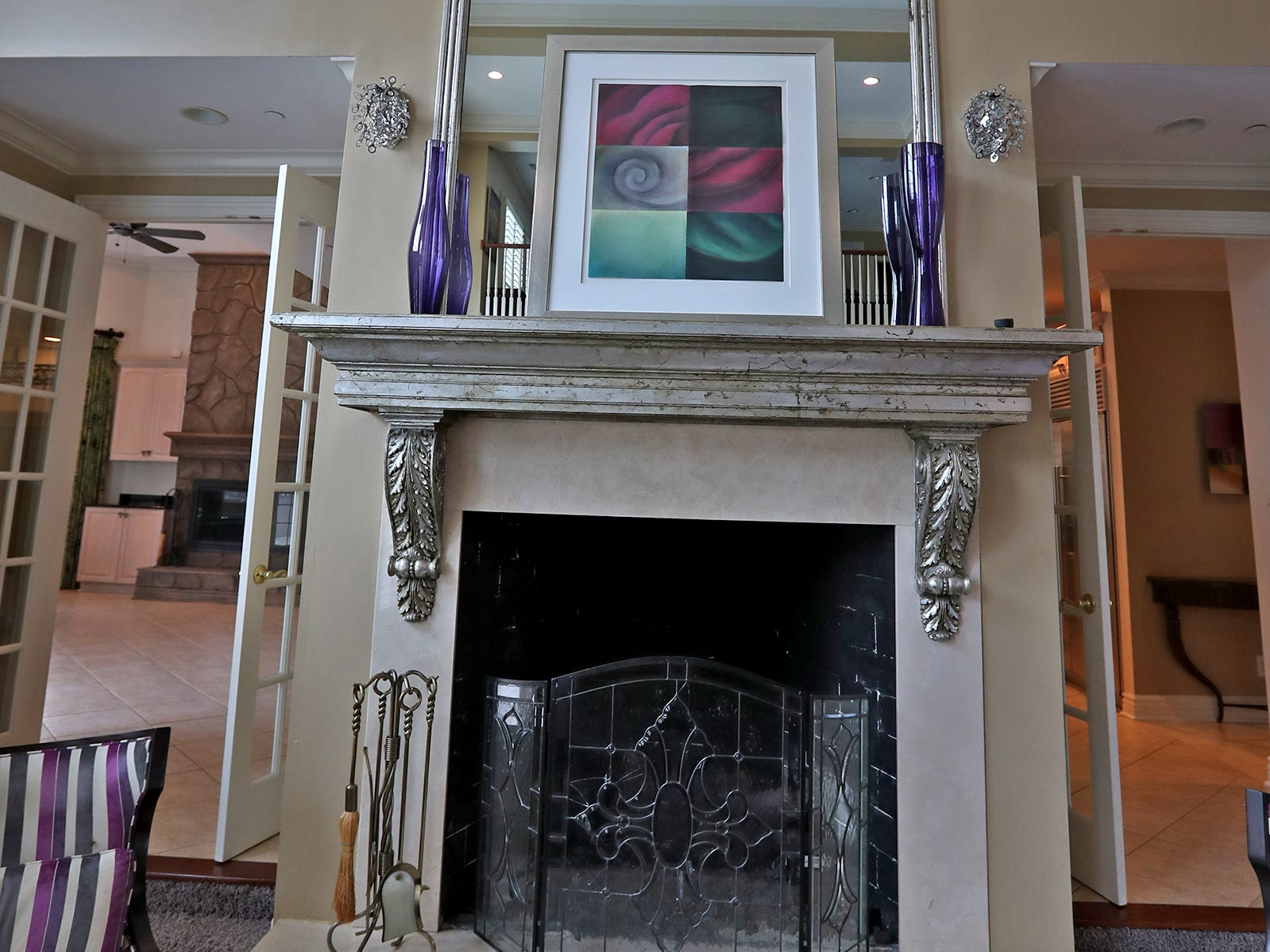 This is the fireplace in the two-story living room in the home at 1270 Laurelwood Ct. in Carmel, Friday, Dec. 28, 2018.