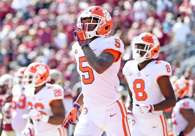 Tigers wide receiver Tee Higgins (5) celebrates after a touchdown during the first half against the Florida State Seminoles at Doak Campbell Stadium.