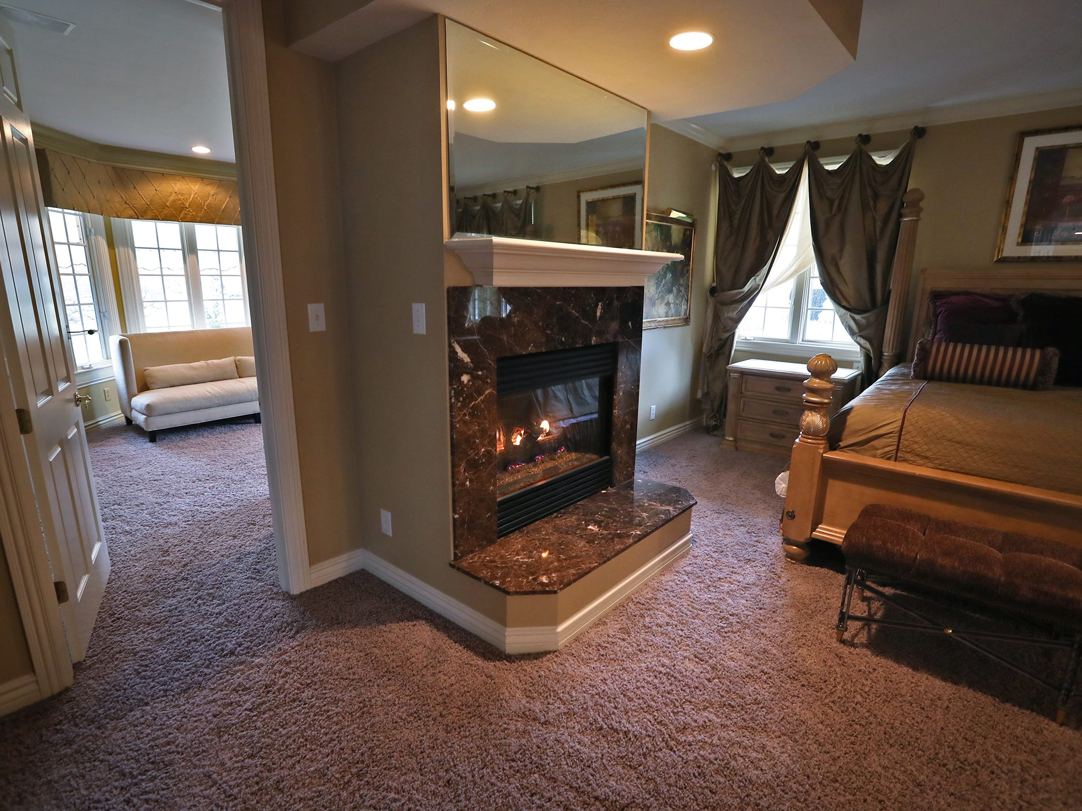 This is the master bedroom in the home at 1270 Laurelwood Ct. in Carmel, Friday, Dec. 28, 2018.  It includes a sitting room, left, and a two-sided fireplace.