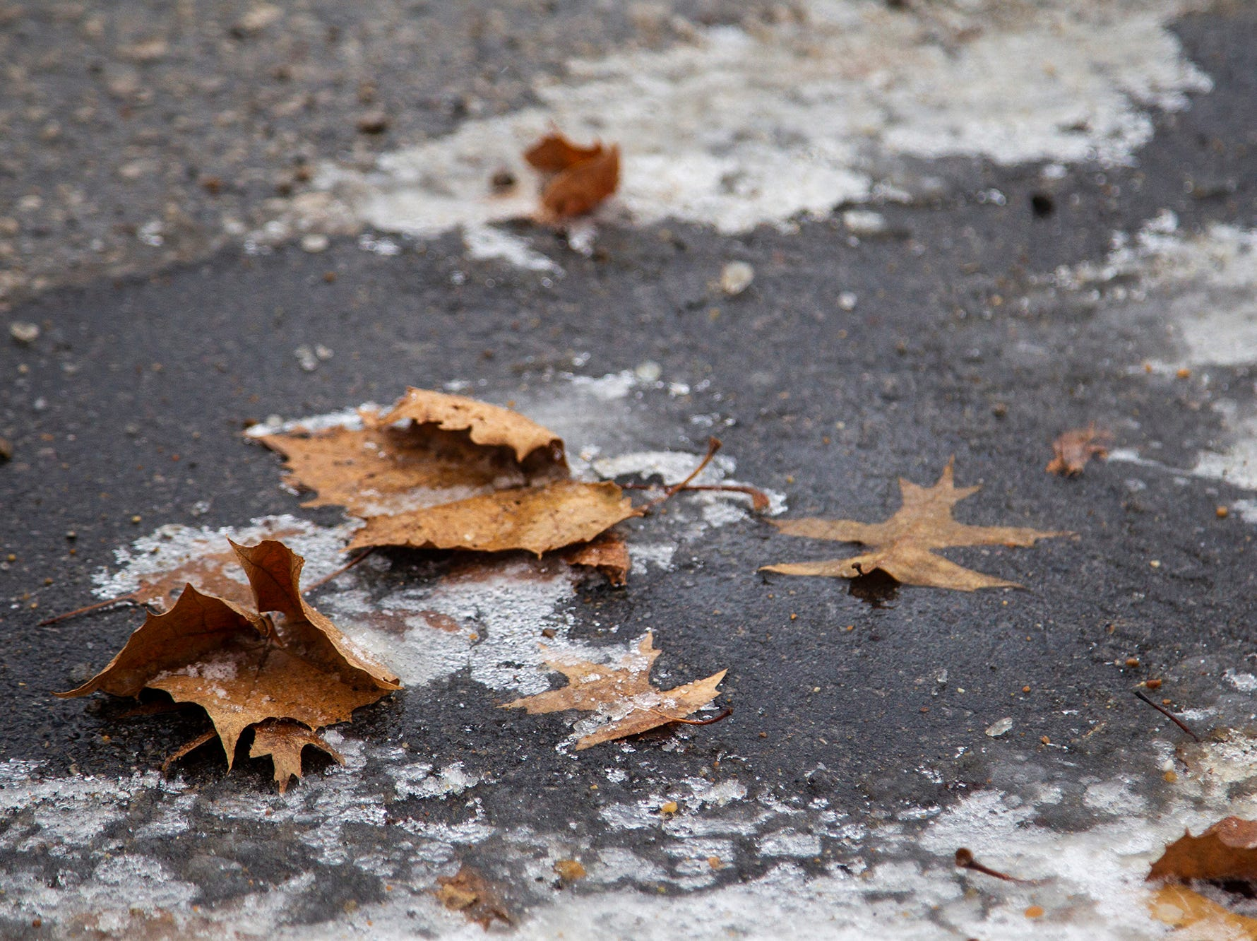 Icy road conditions are seen on Friday, Dec. 28, 2018, off of Court Street near 2nd Avenue on the east side of Iowa City.
