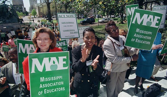 Educators, teachers and parents cheer as a call for higher salaries is issued, March 9, 1999 during a rally at the Capitol in Jackson, Miss. With the 1999 session scheduled to adjourn Easter Sunday, teacher pay is still in the air as two plans are before lawmakers needing compromise. Several hundred marchers from across the state joined together in solidarity and following a march on the Capitol, lobbied lawmakers for salary and education support. (AP Photo/Rogelio Solis)