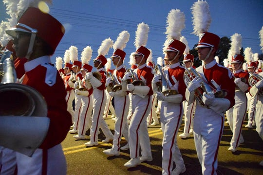 The Munford High School Band marches during its Christmas Parade. The band is one of only five high school bands from across the nation and the only Tennessee band chosen to perform at the annual New Year's Day Tournament of Roses Parade.