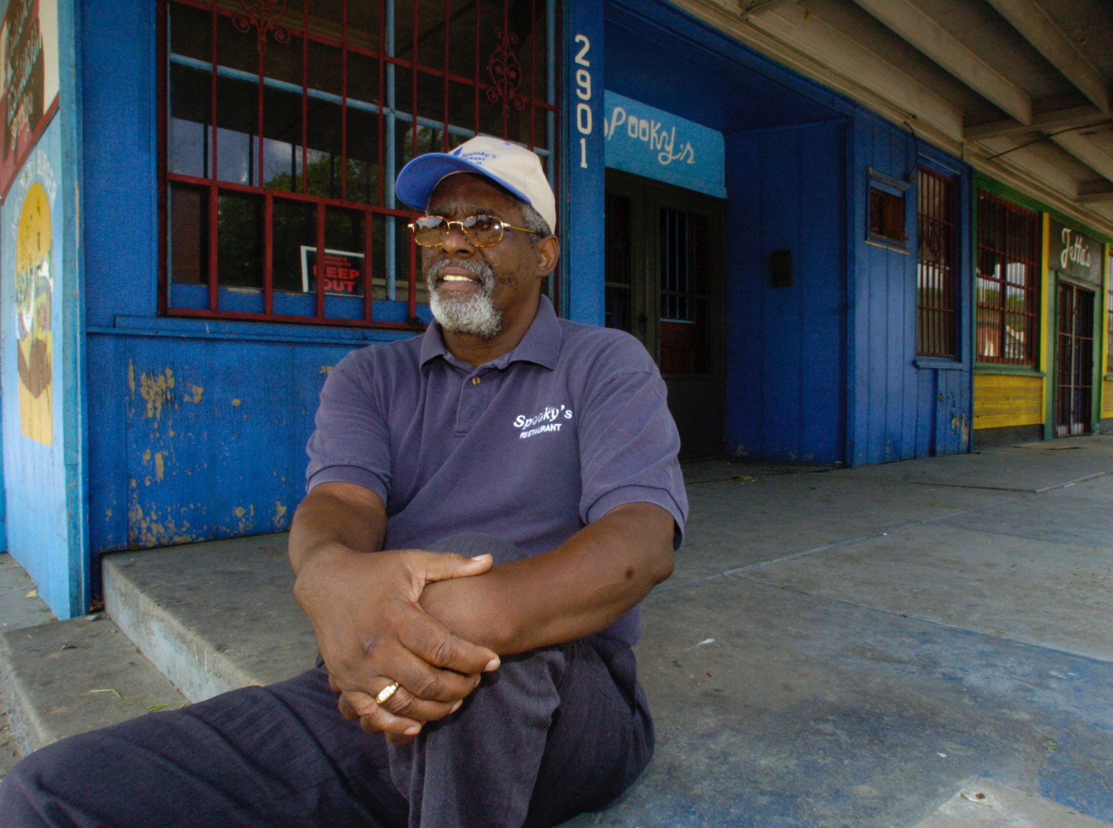 "In May 2004, Clark ""Spooky"" Frazier sits in front of the restaurant he used to operate on Martin Luther King Jr. Avenue at a time when gang violence was prevalent in the community. Frazier, who now operates Spooky""s restaurant in Bearden, says he would love to return to East Knoxville to operate a business and is not upset over authorities' labeling of a small section of the community as a dangerous ""gun zone.""  Frazier is now in the process of opening another barbecue restaurant on Gov. John Sevier Hwy. near the Forks of the River Industrial Park."
