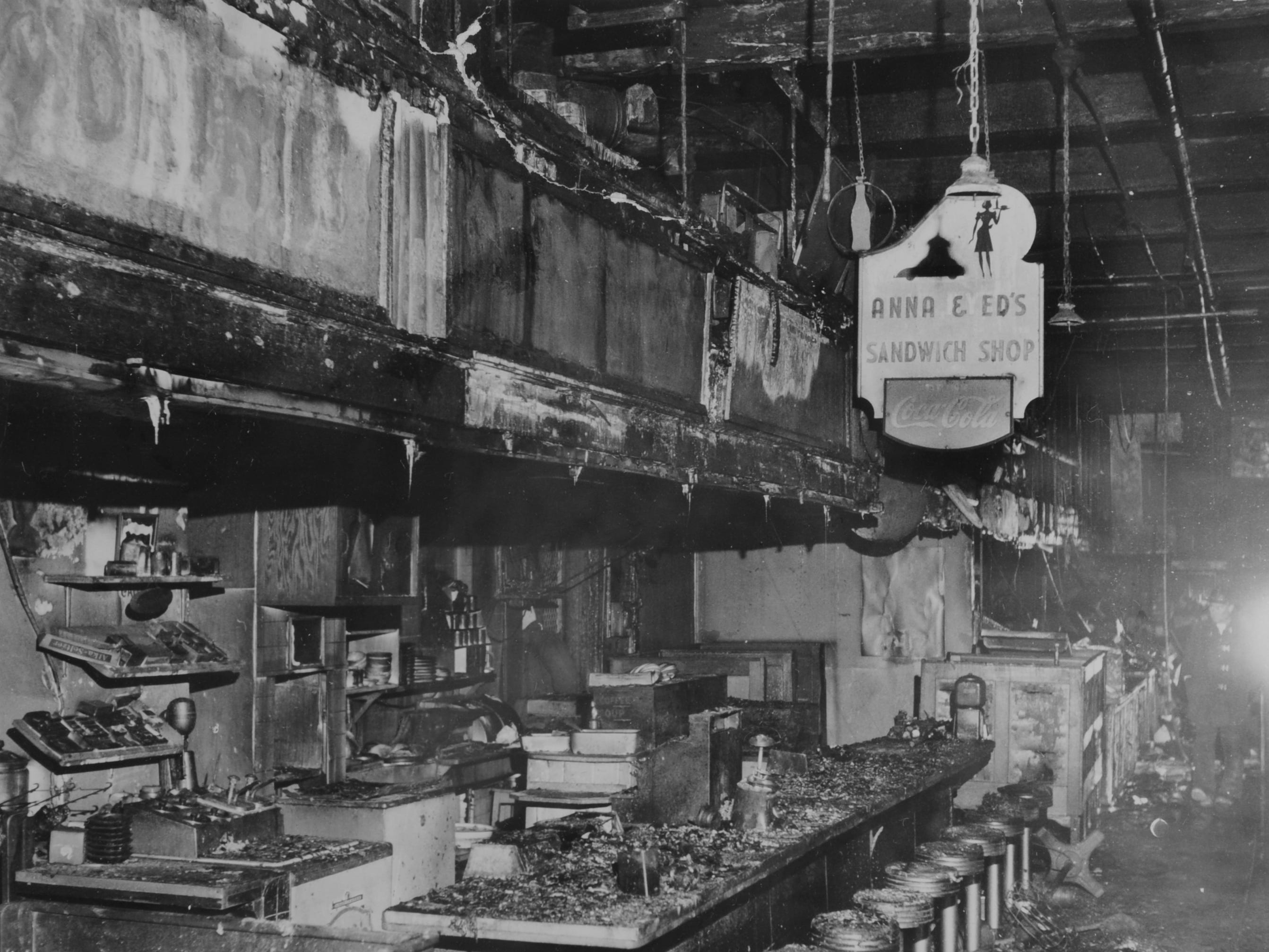 In a Dec. 7, 1959 photograph, Anna & Ed's Sandwich Shop in the Market House is seen after being gutted by fire.