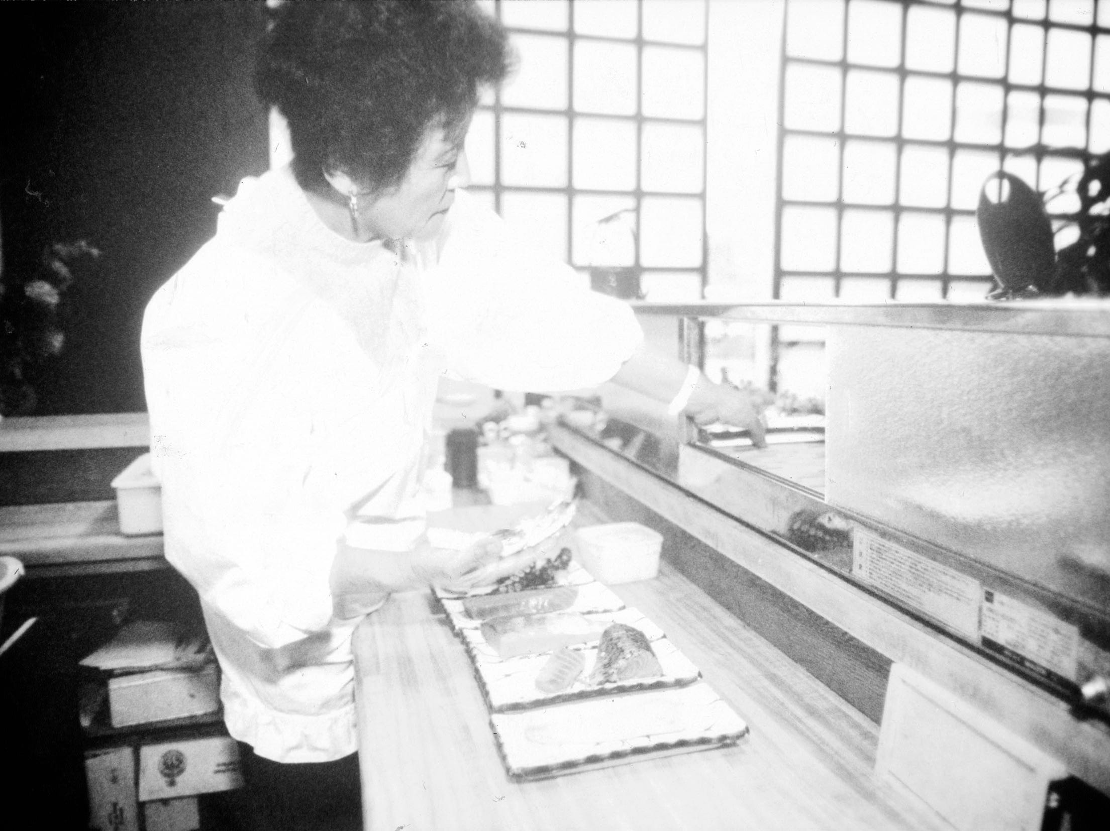 "Akiko Hall, proprietor of Knoxville's only Japanese Sushi Bar, prepares sushi for a busy night at Tomo Japanese Restaurant 112 South Central St. in January 1991. Hall, who has owned the restaurant for 4 years, says the typical sushi eater is a person ""with an open mind."" Hall also indicated that most of her customers are no native East Tennesseans, but of those who have moved here from other metropolitan area."