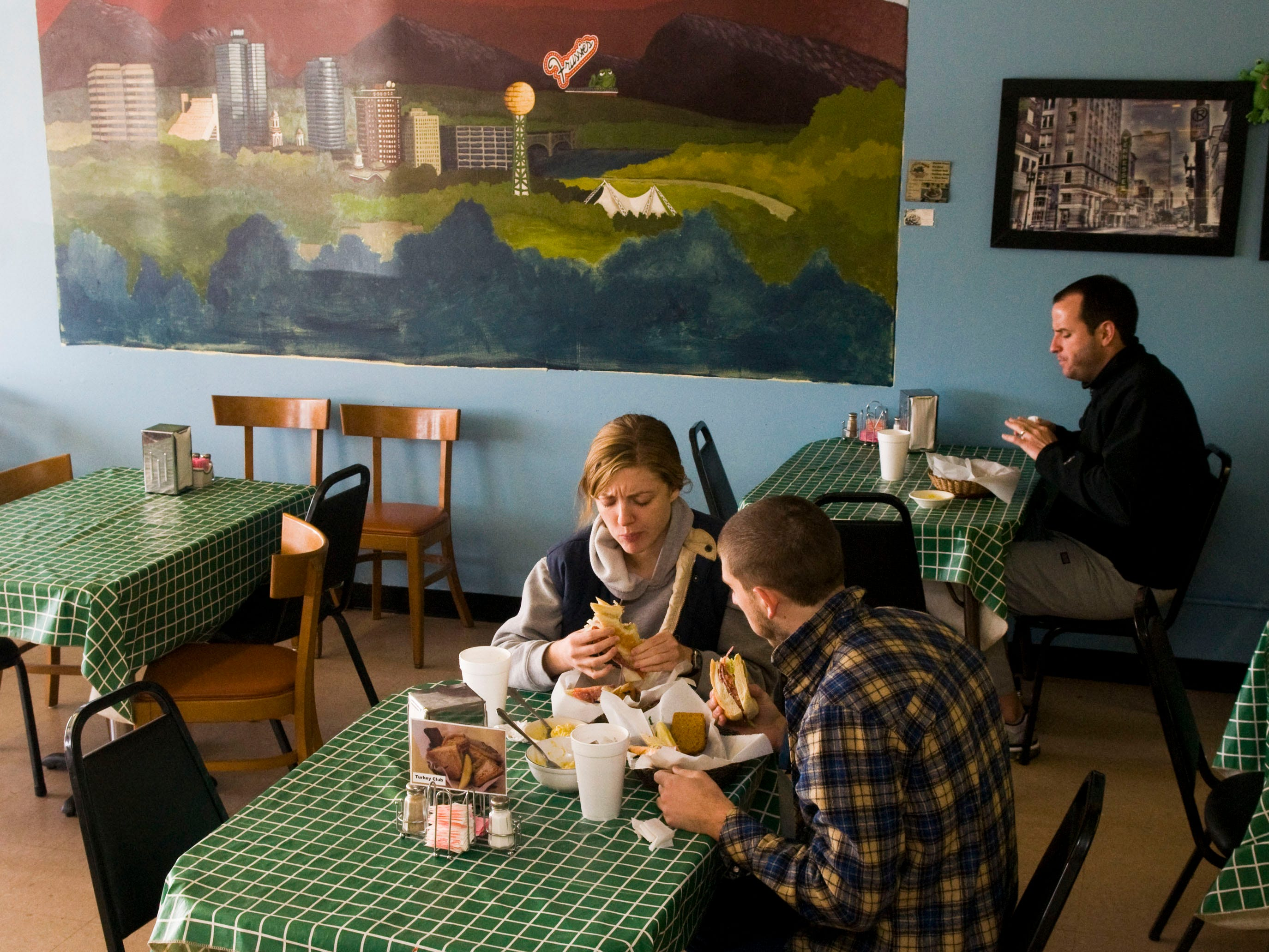 Meredith Robinson and Lawrence Ferris have lunch at Frussie's sandwich shop on Moody Ave in South Knoxville in 2010.