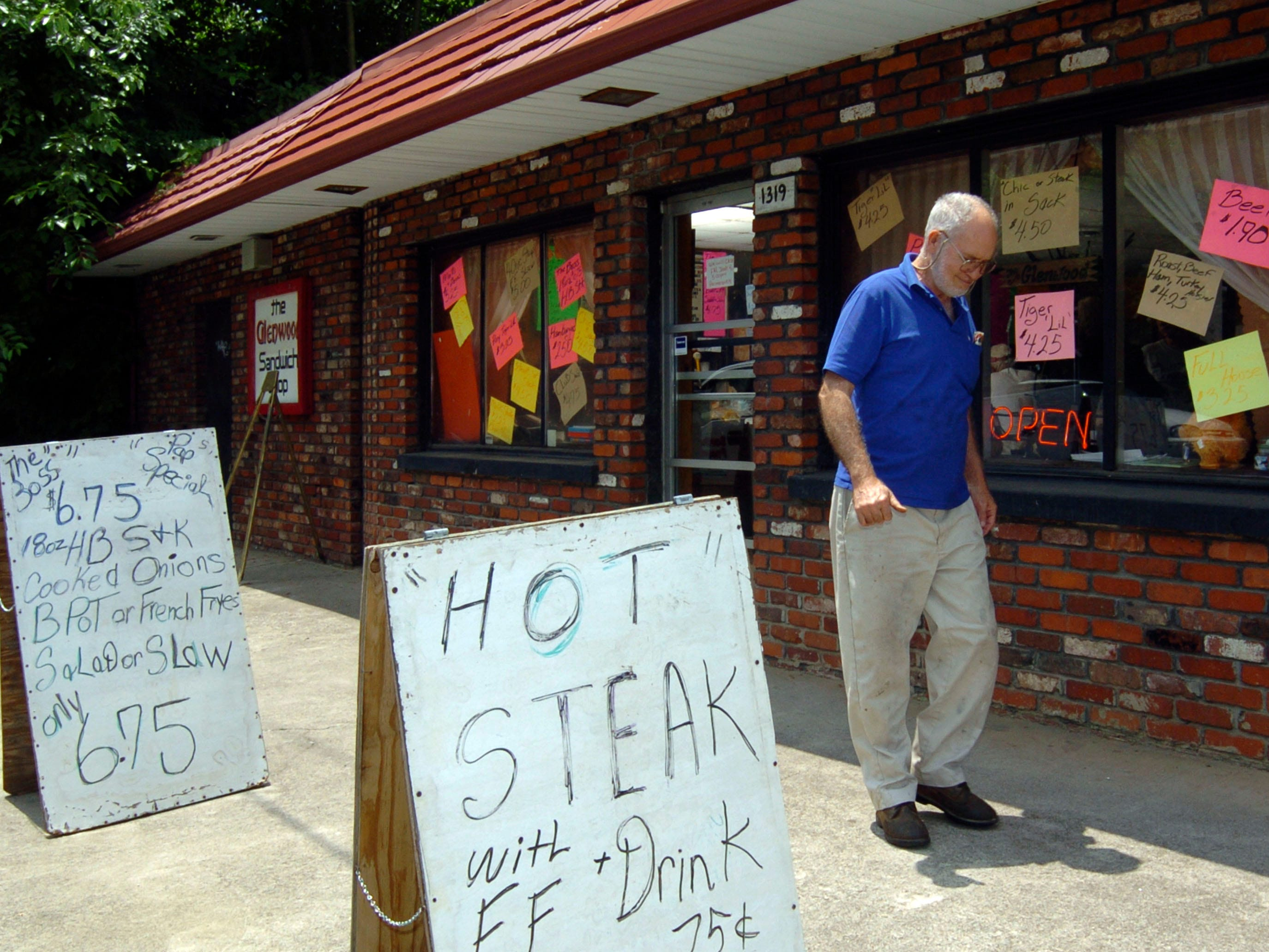 Jack Sartin, 72, leaves the Glenwood Sandwich Shop for the last time Thursday, June 3, 2004 in the Fourth and Gill neighborhood. Sartin said he has been a customer at the sandwich shop for 56 years and will be sorry when when it closes the next day.