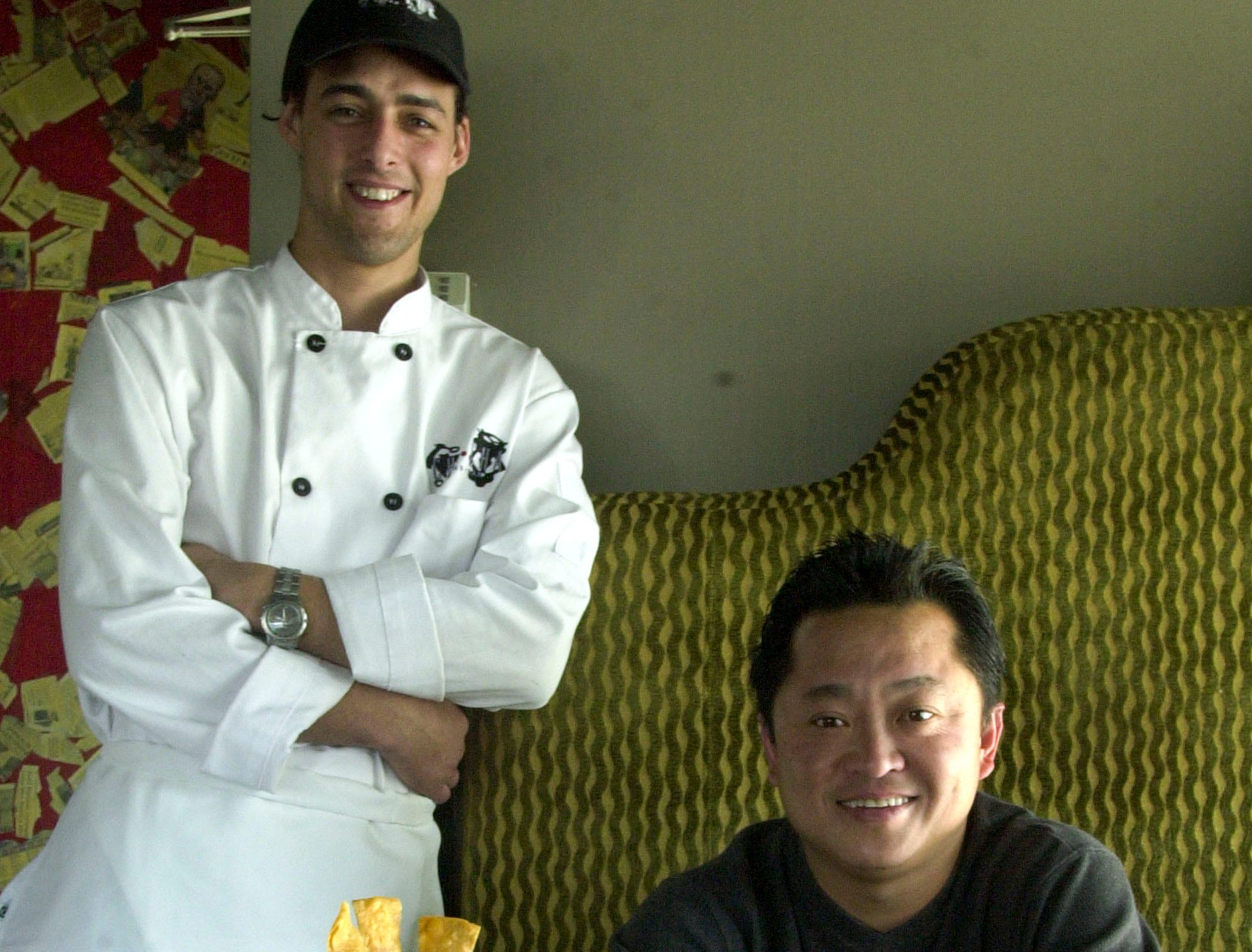 Cha Cha restaurant chef Cardiff Creasey and owner Kenny Siao with some of the Tapas dishes they serve in 2001.