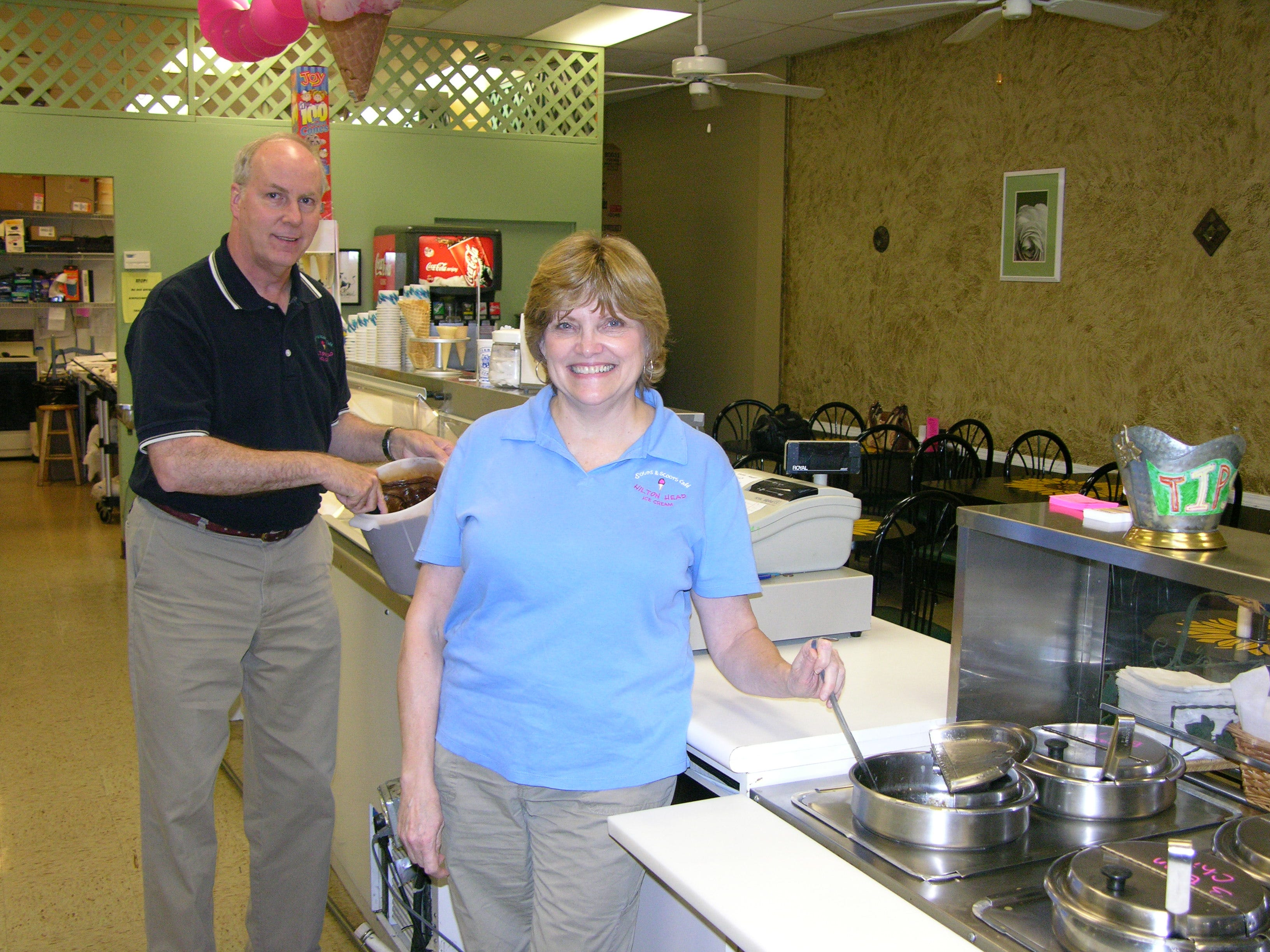 in 2007, Soups & Scoops CafŽ owner Rachel Wilkinson stirs a pot of one her homemade soups while hubby Ron Wilkinson, who serves as ice cream manager, dips into one of the more than 40 flavors of handmade ice cream and sorbet the restaurant offers.