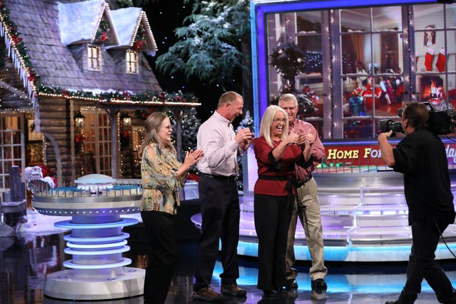 "Lucinda Tillett, in red, celebrates winning $69,000 on ""Wheel of Fortune."" The episode was filmed in October, but aired on Christmas."