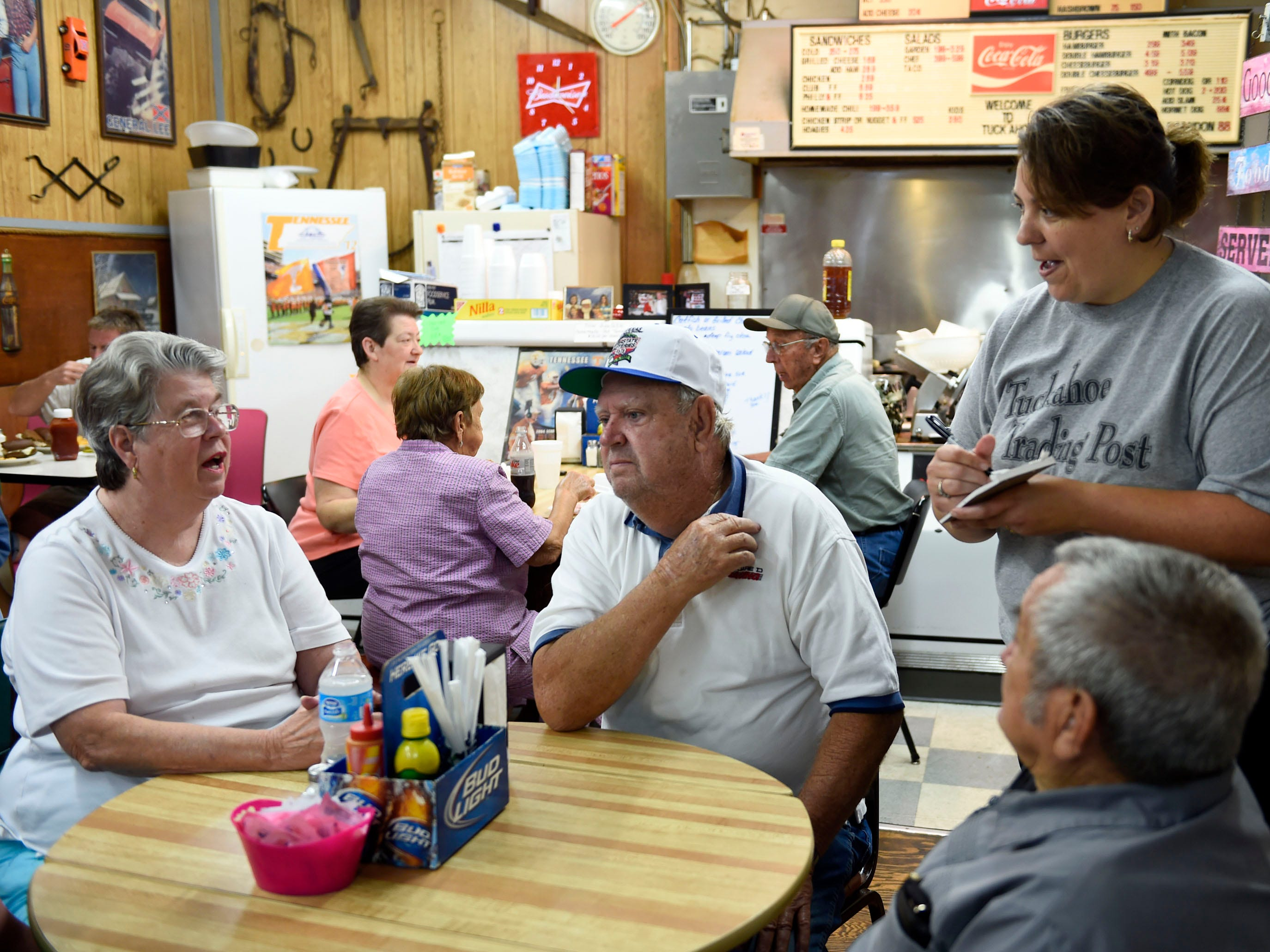 Co-owner Kim Maples-Worley, right, takes a lunch order for customers Pat and Gerald Snyder and Charles Farmer at the Tuckahoe Trading Post on Kodak Rd., Friday, Aug. 8, 2014.