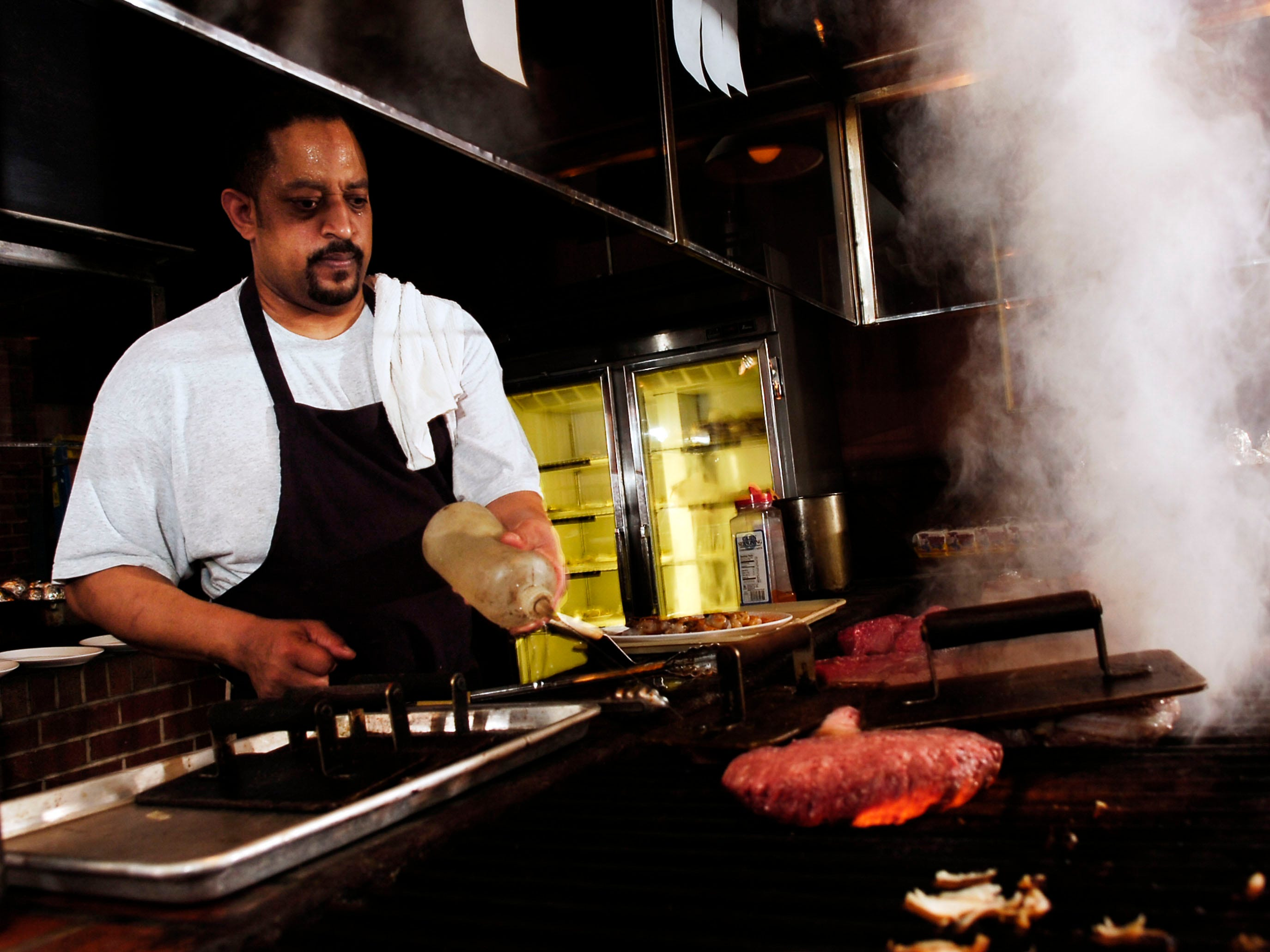 Gary Powell at the grill in at the Butcher Shop Steakhouse in World's Fair Park in 2007.
