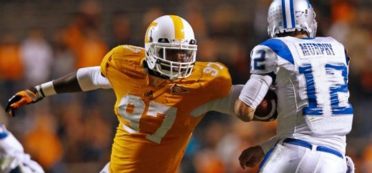 Tennessee defensive lineman Malik Jackson (97) pressures Middle Tennessee quarterback Jeff Murphy (12) in the third quarter of an NCAA college football game, Saturday, Nov. 5, 2011, in Knoxville, Tenn. Tennessee won 24-0.