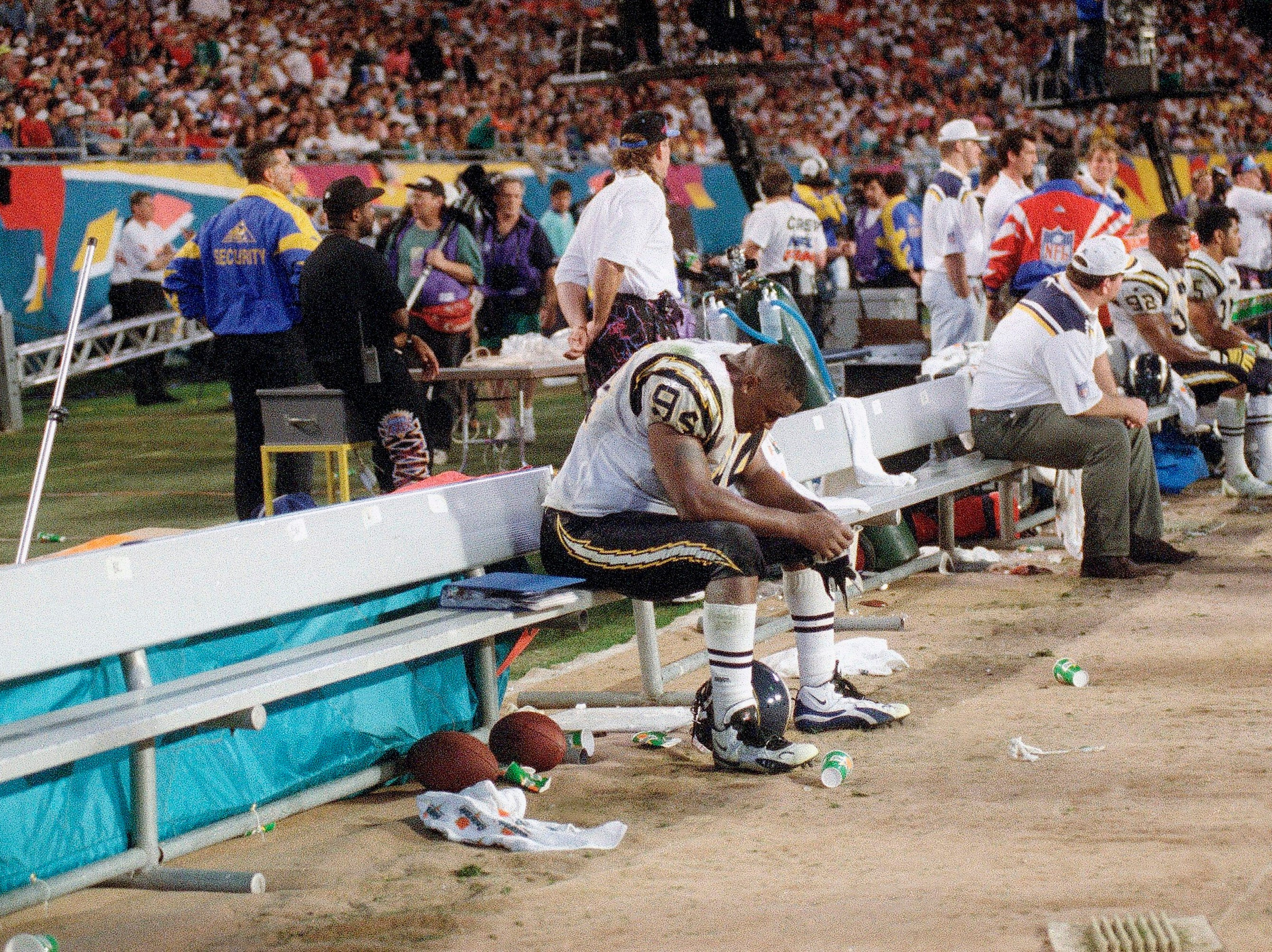 San Diego Chargers Chris Mims sits dejectedly on the bench during his team's 49-26 loss to the San Francisco 49ers in Super Bowl XXIX in Miami on Jan. 29, 1995. (AP Photo/Lenny Ingelzi)