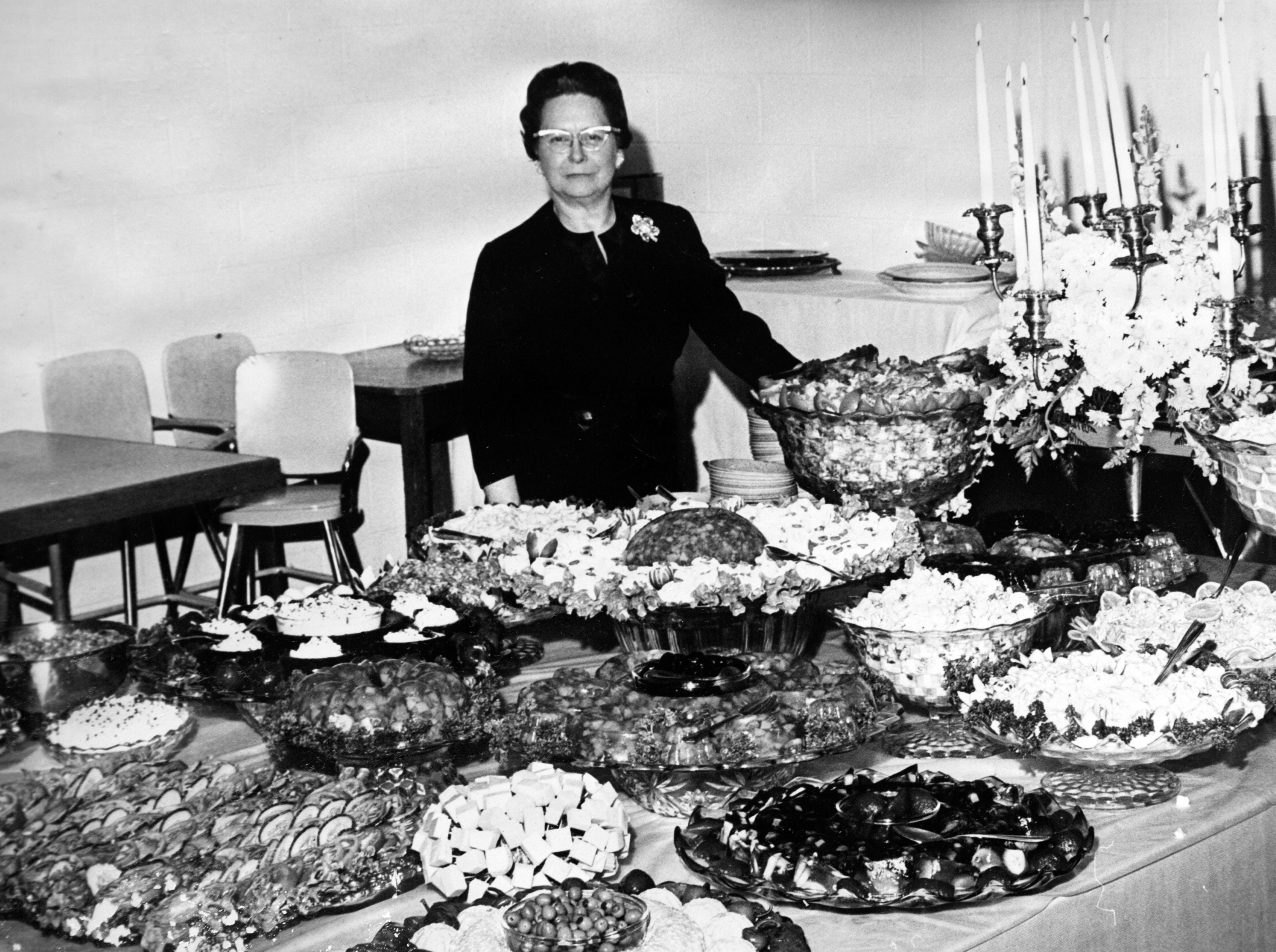 Helma's restaurant owner Helma Gilreath shows off a buffet in the 1960s. Gilreath's restaurant was one of the first in the county to end the policy of segregation in the 1960s.