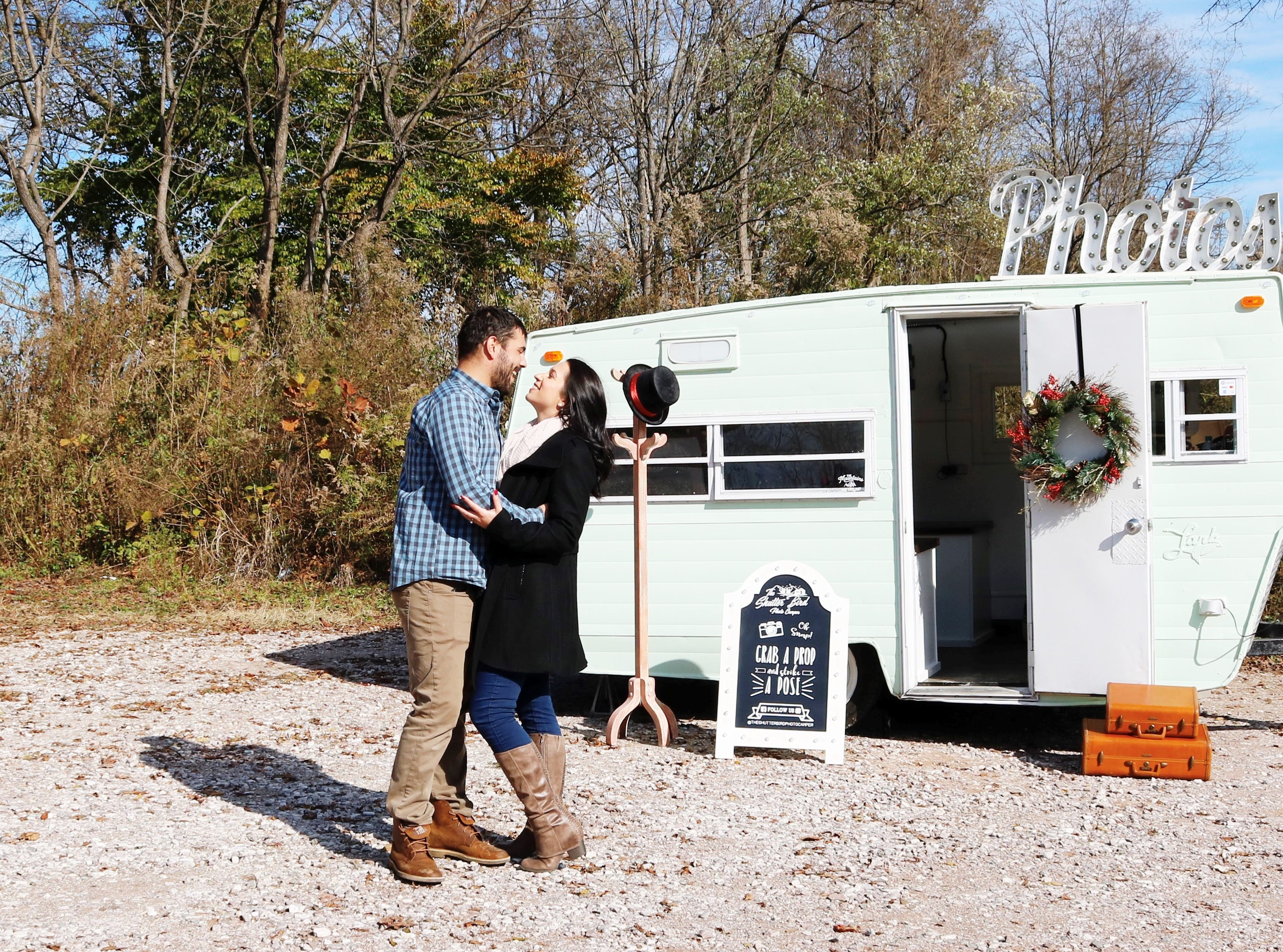 "Amanda Irizarry and fiancé Bryan Bates outside the Shutter Bird Photo Camper. ""I was thinking about this venture night and day and woke up in the middle of the night and wrote 'The Shutter Bird' down in my notes as a possible name for the business (I had a whole list of names) and in the morning I went out to my car and realized the camper is a 1970s Lark,"" she said. ""And since Lark is a type of bird it just kind of fit. And we named her Luna because she looked like a Luna to me and it's what I called her from day one. Luna the lark."""
