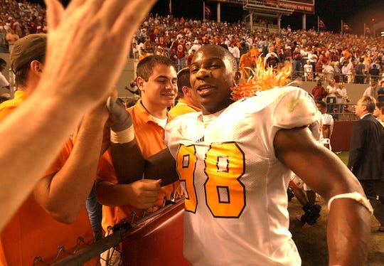 Tennessee's (98) Parys Haralson heads for the fans at the end of the fifth overtime and the win  over Alabama.        10/25/2003