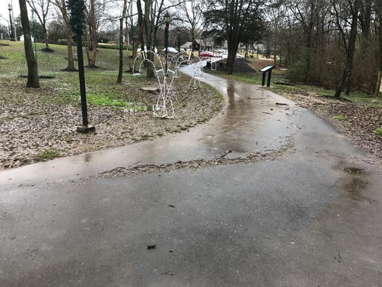 The North fork of Turkey Creek in Founder's Park overflowed after heavy rain caused flash flooding in Farragut on Friday, Dec. 28, 2018. The creek flooded sidewalks as well as the Town of Farragut's Christmas decorations in the park.