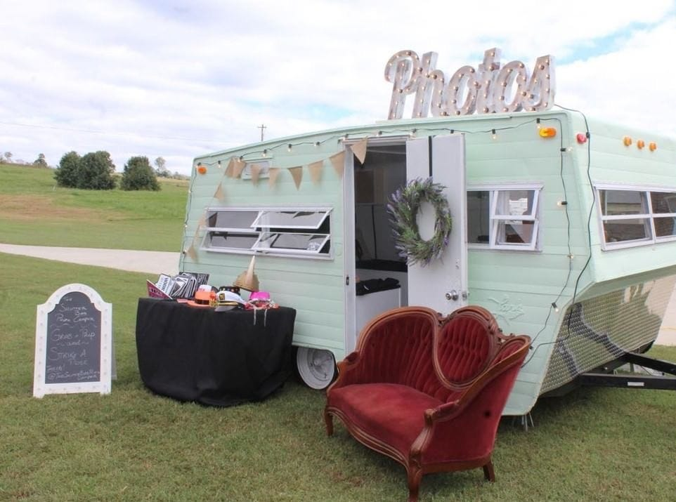 """I love supporting small businesses,"" said Amanda Irizarry of the process of decorating the Shutter Bird Photo Camper. ""I shopped on Etsy as much as I could, and found the custom made ""Photos"" sign that lights up."""