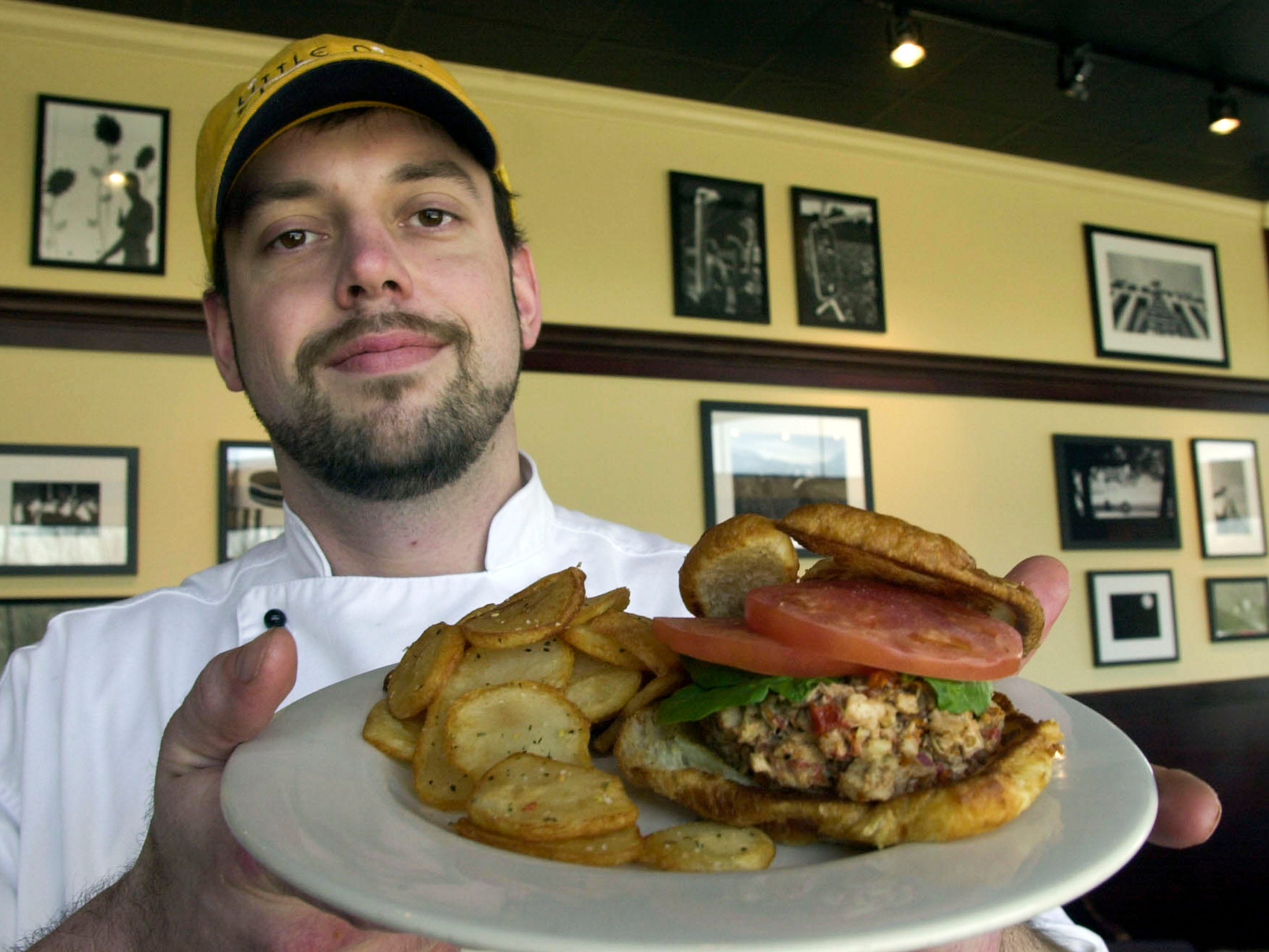 Mark McKinney, head chef at Little City Restaurant in Farragut, presents his sun-dried tomato chicken salad sandwich in 2001.