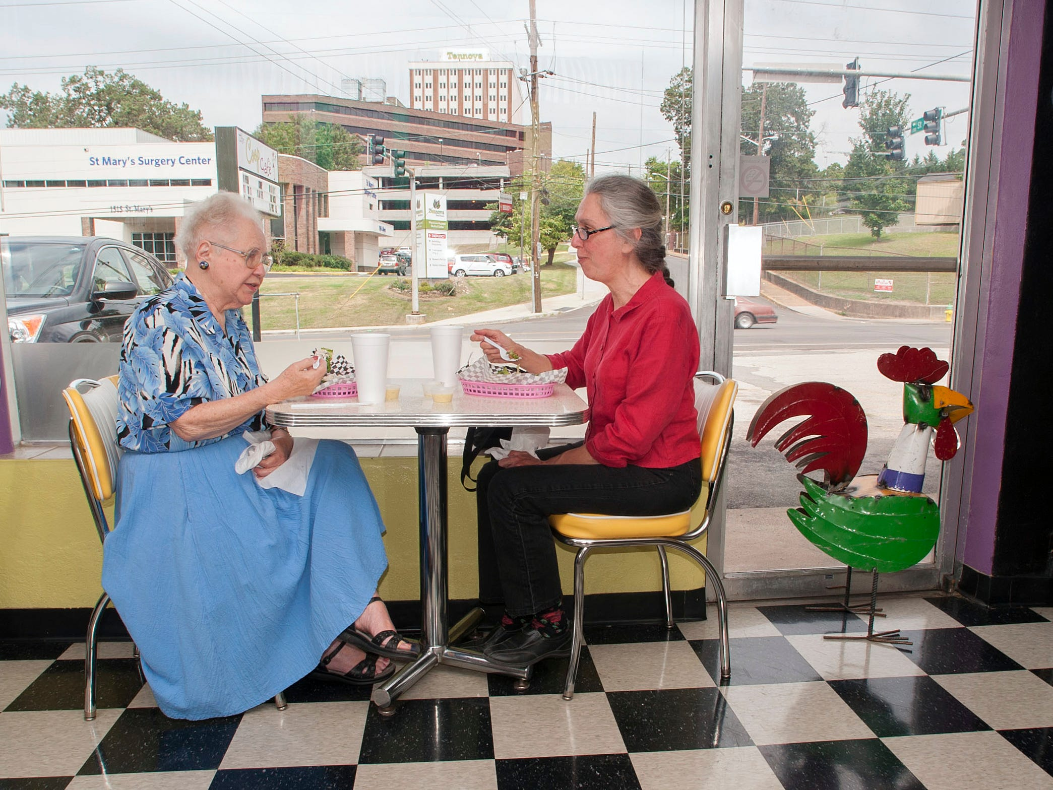 Lois Russell, left and Patty Cooper eat lunch at the Coop Cafe Tuesday August 6, 2013. The Coop Cafe sits just blocks from Physicians Regional Medical Center at 1008  East Woodland Ave.The small Cafe operated by Nancy Kendrick is bracing for a future when the Medical Center relocates in West Knoxville.  Kendrick who opened her restaurant a year ago across from the hospital, says they need to make the neighborhood busier not less.