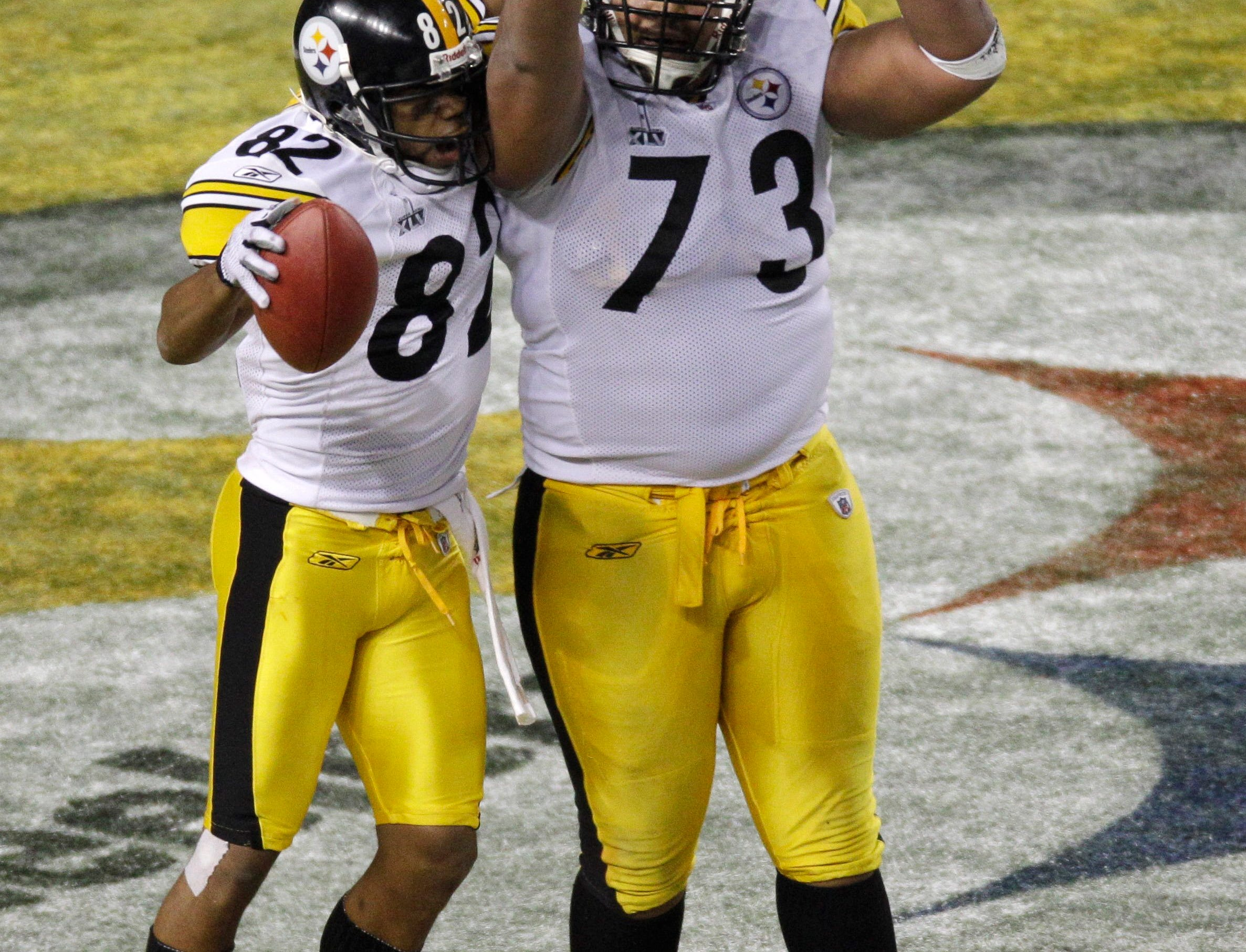 Pittsburgh Steelers' Ramon Foster (73) celebrates with Antwaan Randle El (82) following Randle El's reception for a two-point conversion during the second half of the NFL Super Bowl XLV football game against the Green Bay Packers Sunday, Feb. 6, 2011, in Arlington, Texas.