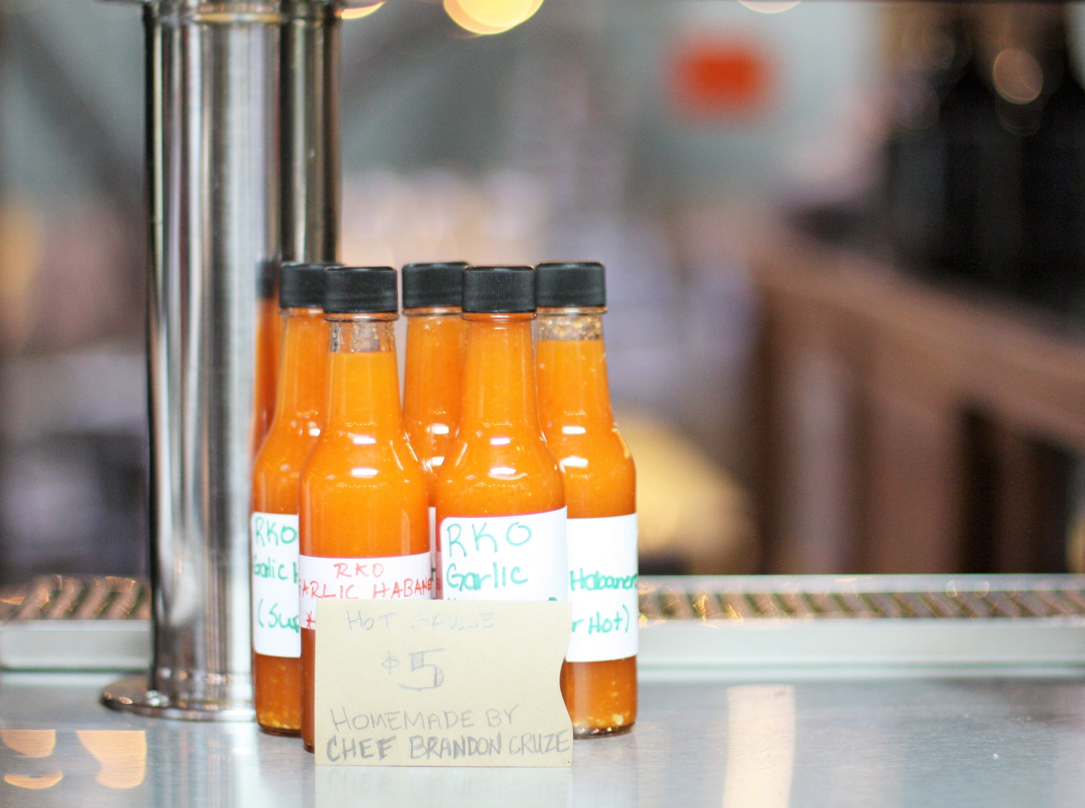 Chef Brandon Cruze's homemade sauces can be purchased to take home.