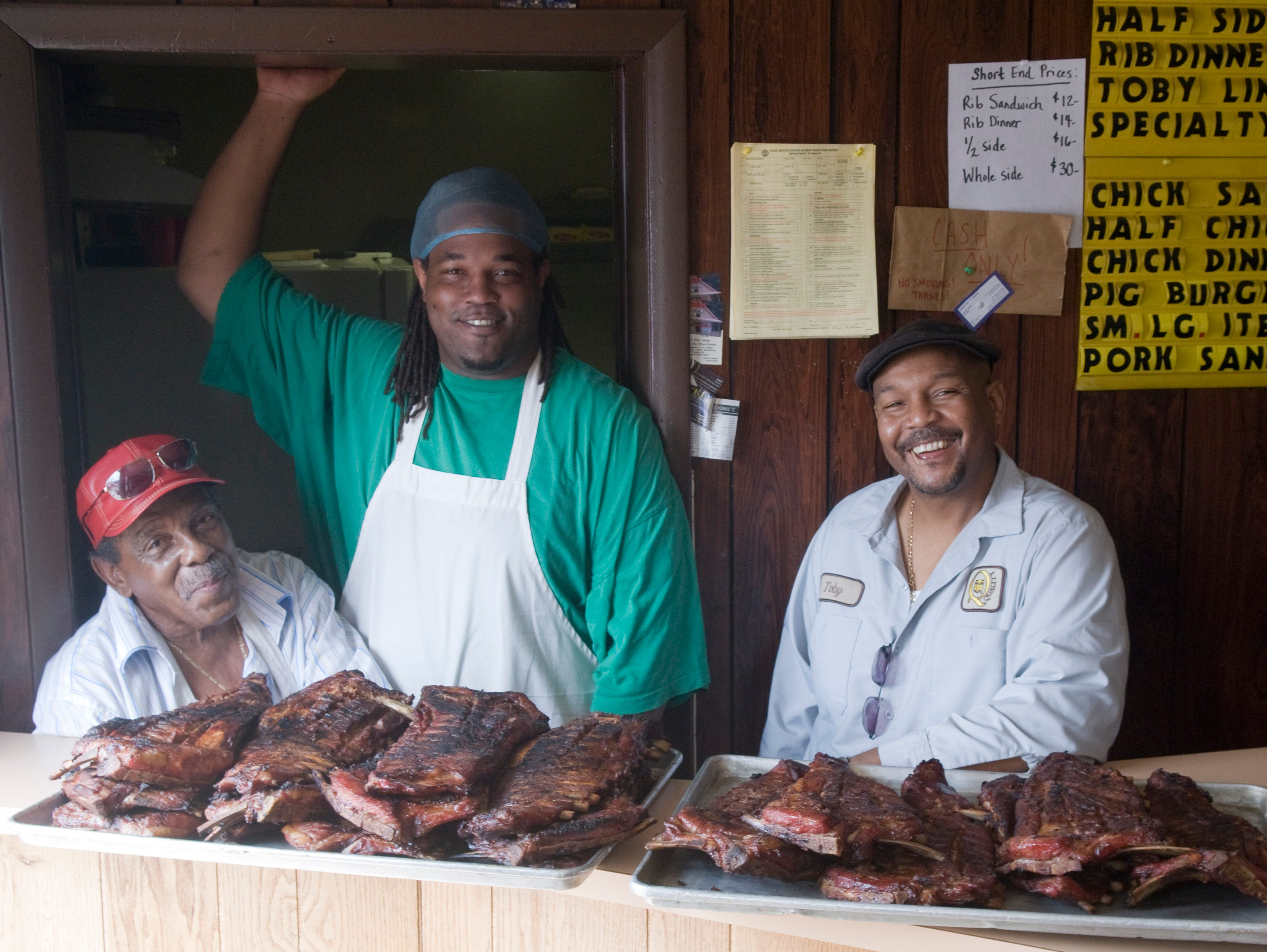 Toby Dixson, right, with his father William Dixson, left, and Wayne McCallie of Dixson's Barbecue in 2010/