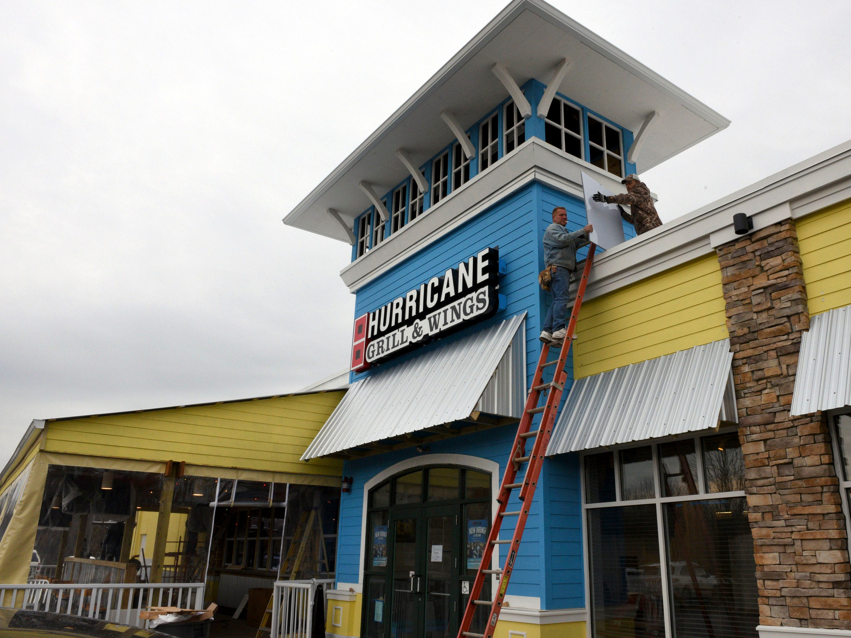 Knoxville resident Henry Sadiq is opening the state's first Hurricane Grill & Wings in the former Ruby Tuesday off Lovell Road. The restaurant officially opens Dec. 8. Corporate training staffers are in town training the staff this week. Thursday, Dec. 4, 2014.