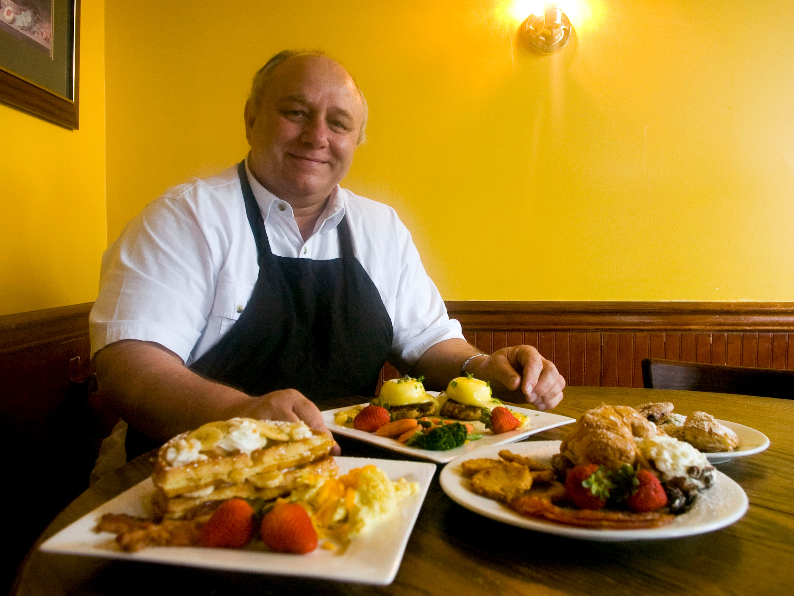 The Creamery Parke Grille at 114 Hotel Rd. was voted best Sunday brunch in the 2009 East Tennessee's Best Reader's Poll. Owner Jeff Patin is pictured on Sunday, Sept. 20, 2009  with a selection of the restaurant's brunch selection from left, banana Foster's waffle, egge benedict, and apple stuffed French toast croissant.