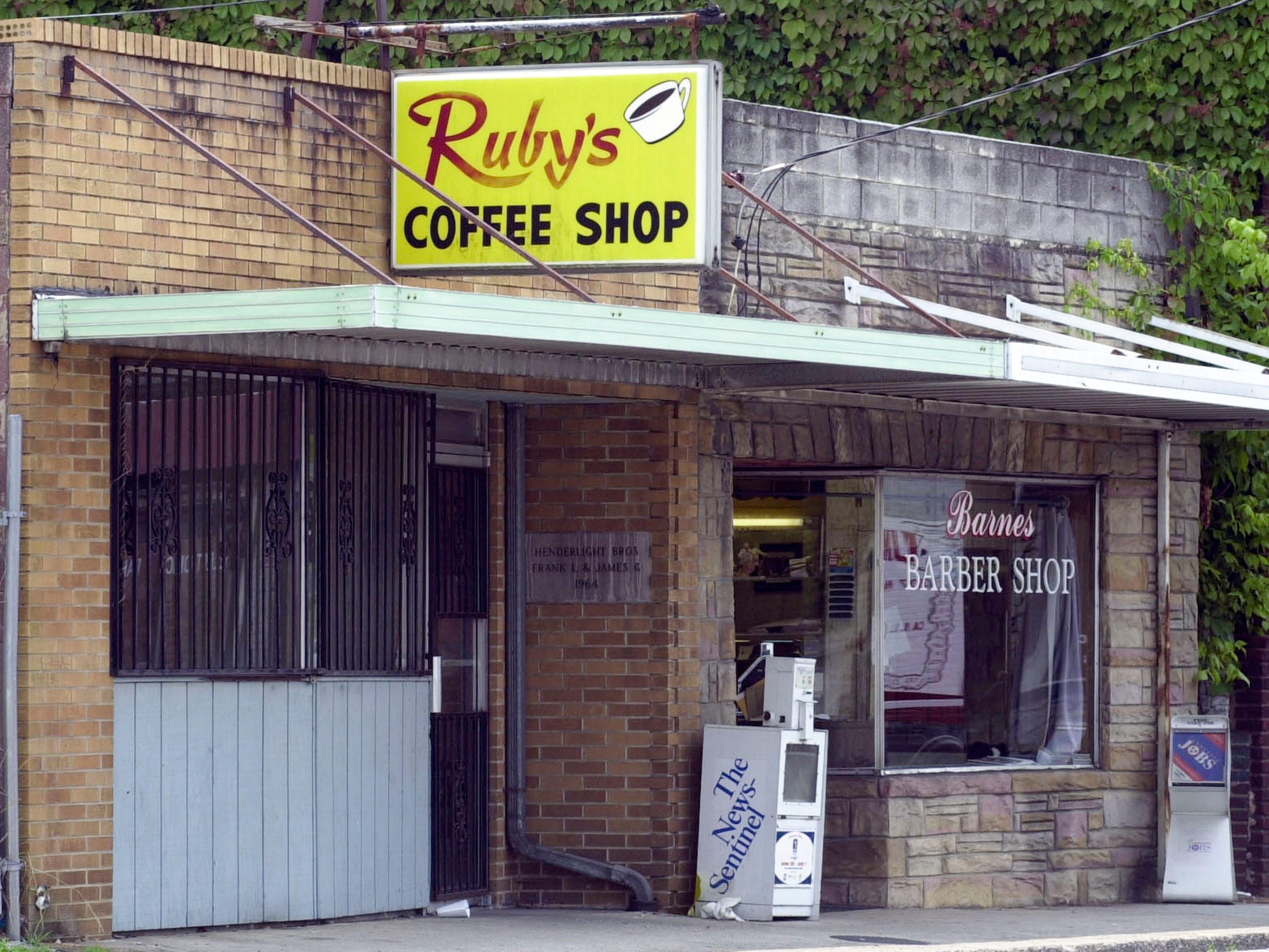 Ruby's Coffee Shop in East Knoxville in 1999. Ruby's is closed, but Barnes Barber is open.