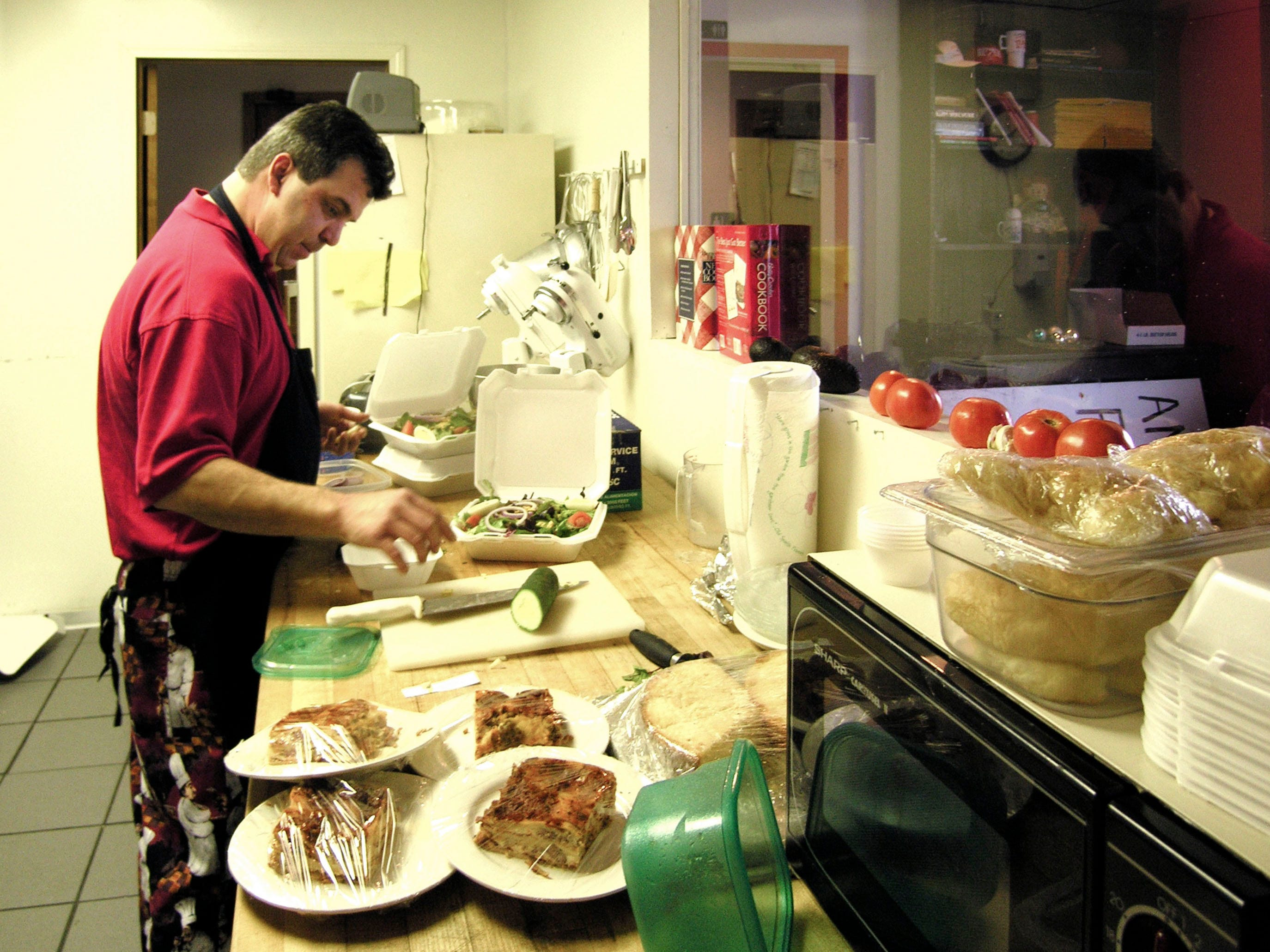 in 2006, Bill Goldman prepares some take-out orders at America Fresh, an Inskip area café owned by his brother, Bryant Goldman and Teresa England.