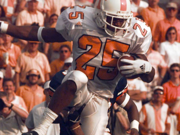 Tennessee's #25-Travis Stephens leaps over Auburn's #36-Kenny Kelly in the fourth quarter Saturday in Auburn, AL. 1998. Michael Patrick/News-Sentinel staff.