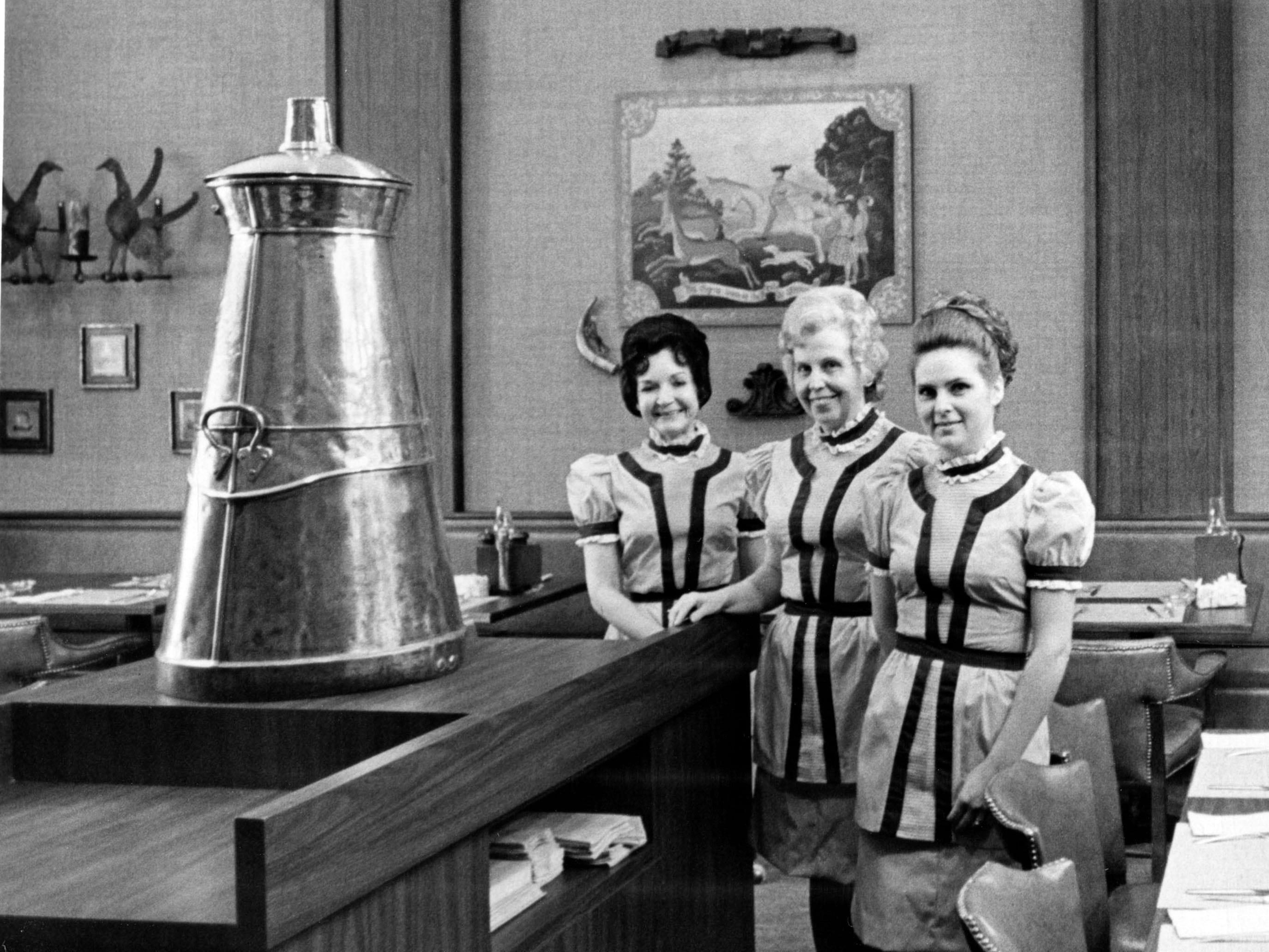 Regas Restaurant waitresses, from left, Bobbie Foley, Hazel Schmid, and Phyllis Whitt in 1973.